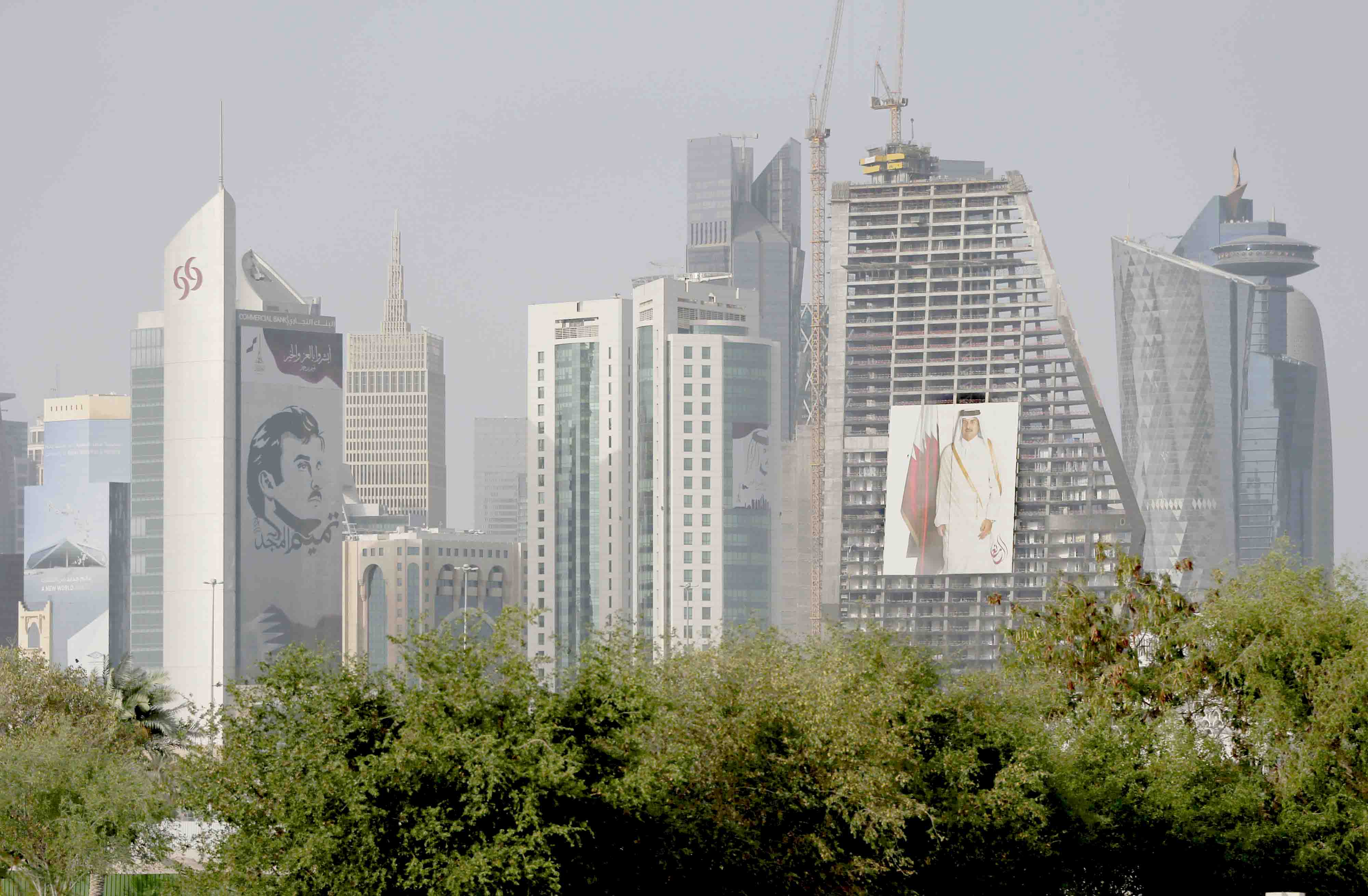 Wherever you turn your eye. Images of the Qatari Emir Sheikh Tamim bin Hamad al-Thani hang on towers in Doha.(AP)