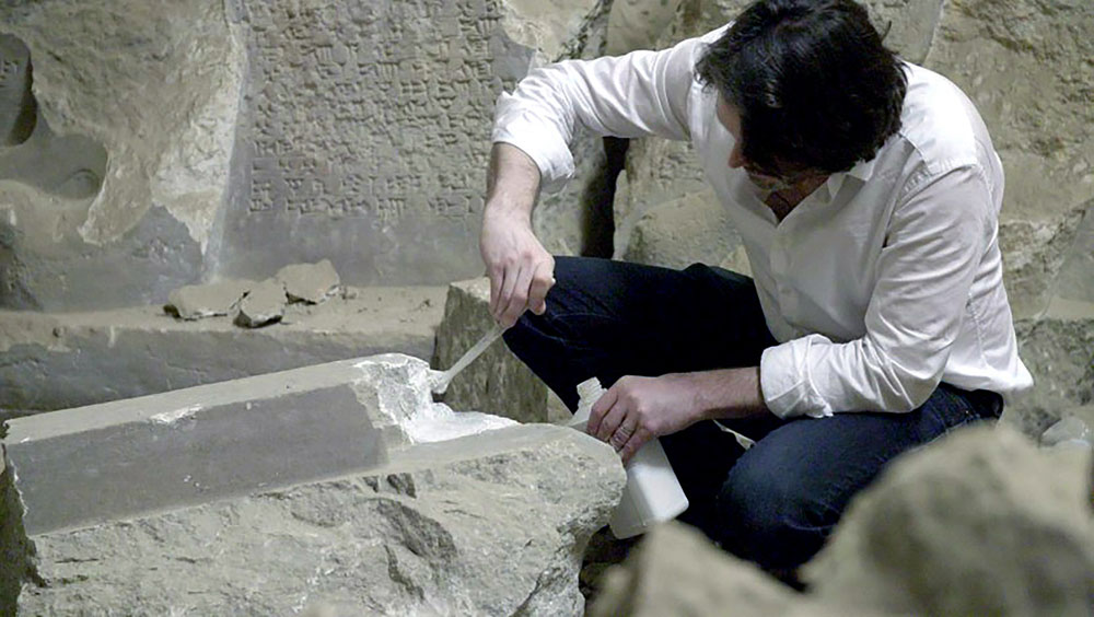 Piers Secunda works on moulds of damaged artefacts in Mosul museum. (Courtesy of Piers Secunda)