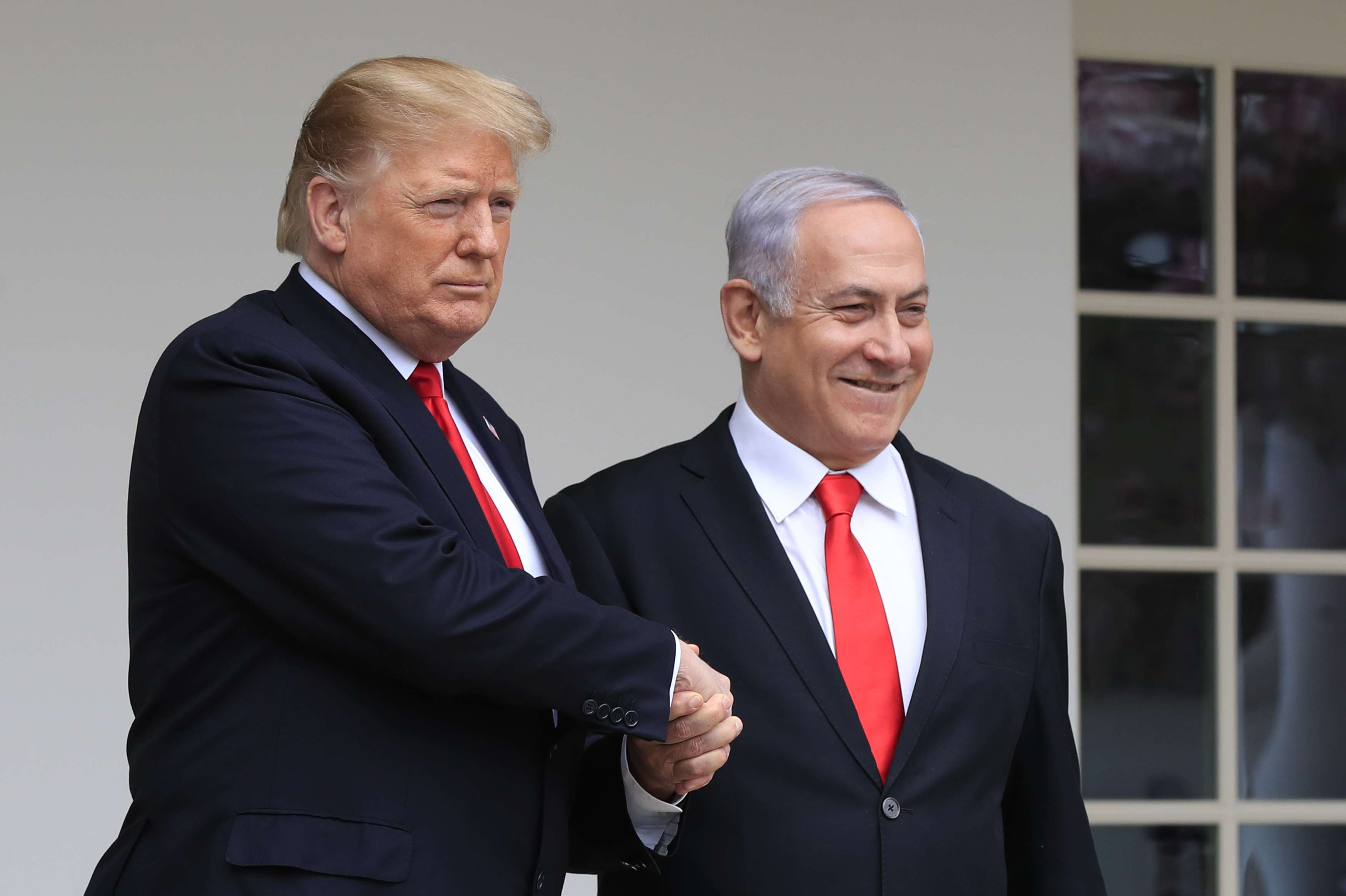 US President Donald Trump welcomes visiting Israeli Prime Minister Binyamin Netanyahu to the White House in Washington, March 25. (AP)