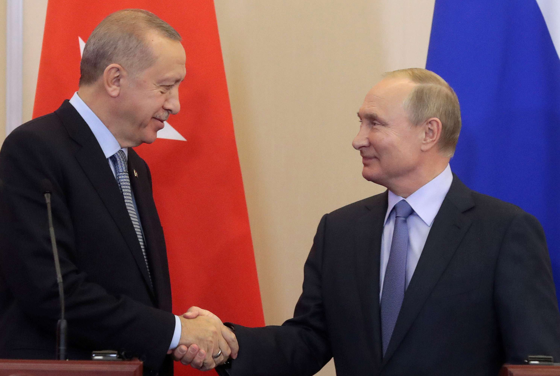 Russian President Vladimir Putin (R) shakes hands with Turkish President Recep Tayyip Erdogan (L) during a joint news conference following Russian-Turkish talks in the Black sea resort of Sochi, Russia October 22. (Reuters)