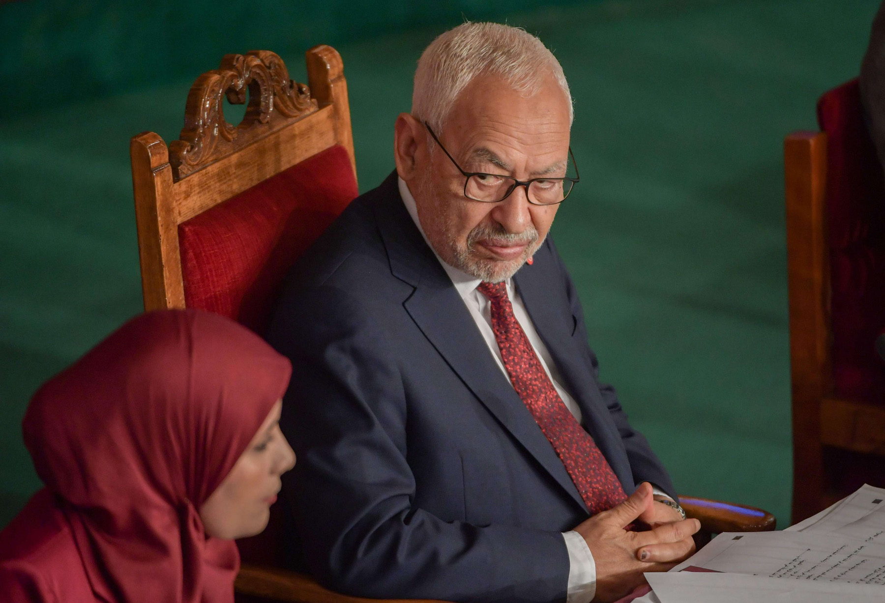 Leader of Tunisia's Islamist Ennahdha movement Rached Ghannouchi (R) chairs the first session of the new parliament, November 13. (AFP)