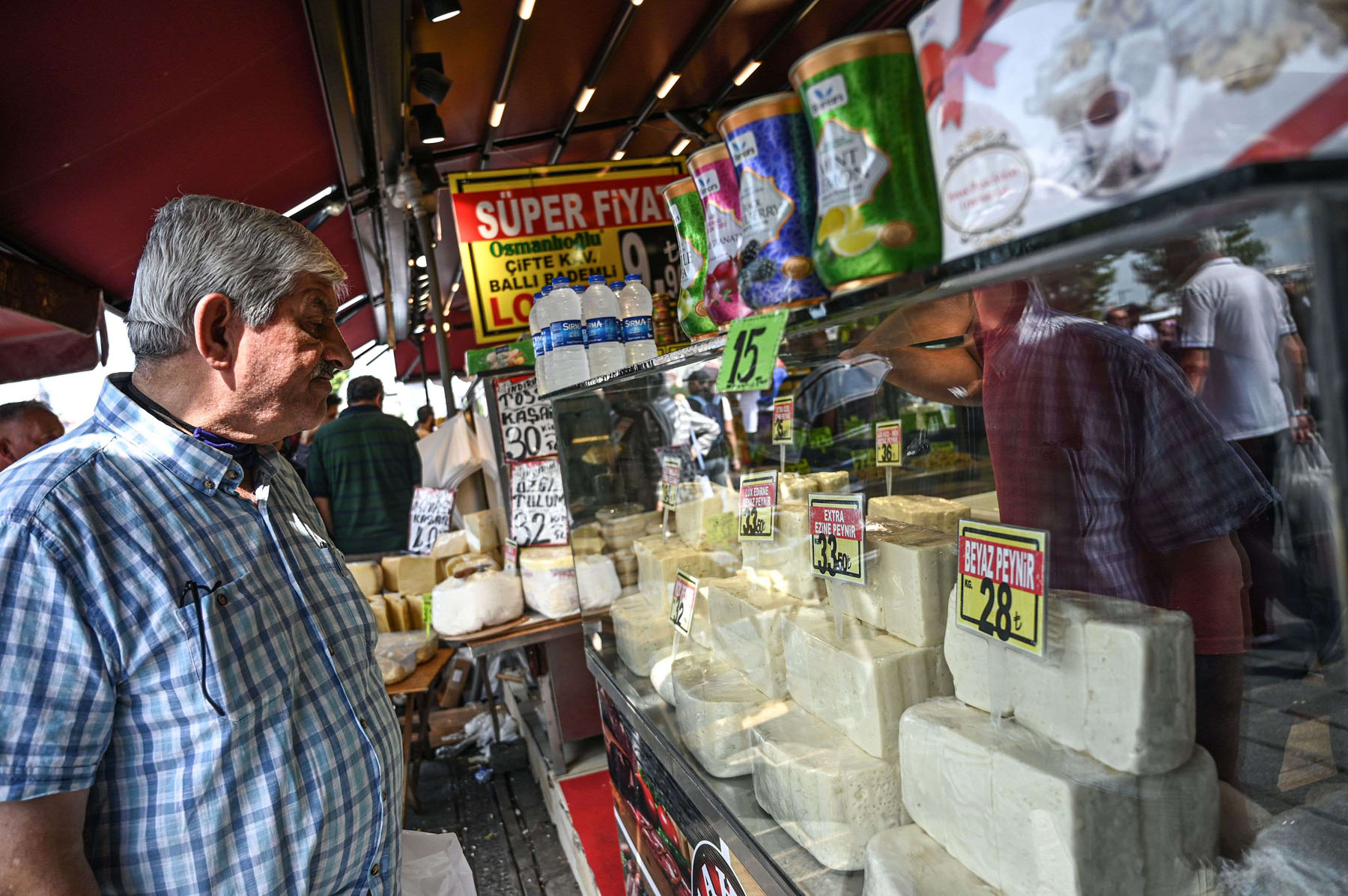 A man looks at cheeses at a shop at the historical spice bazaar at Eminonu district in Istanbul, on July 13. (AFP)