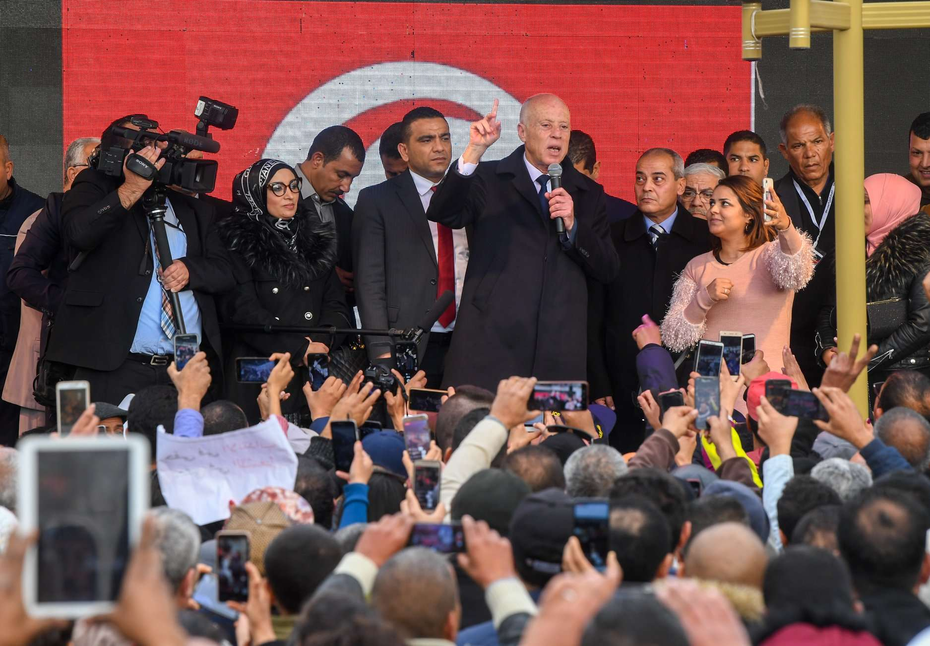 A handout picture provided by the Tunisian Presidency Press Service on December 17, 2019 shows President Kais Saied speaking to a crowd of people in the central Tunisian town of Sidi Bouzid. (AFP)