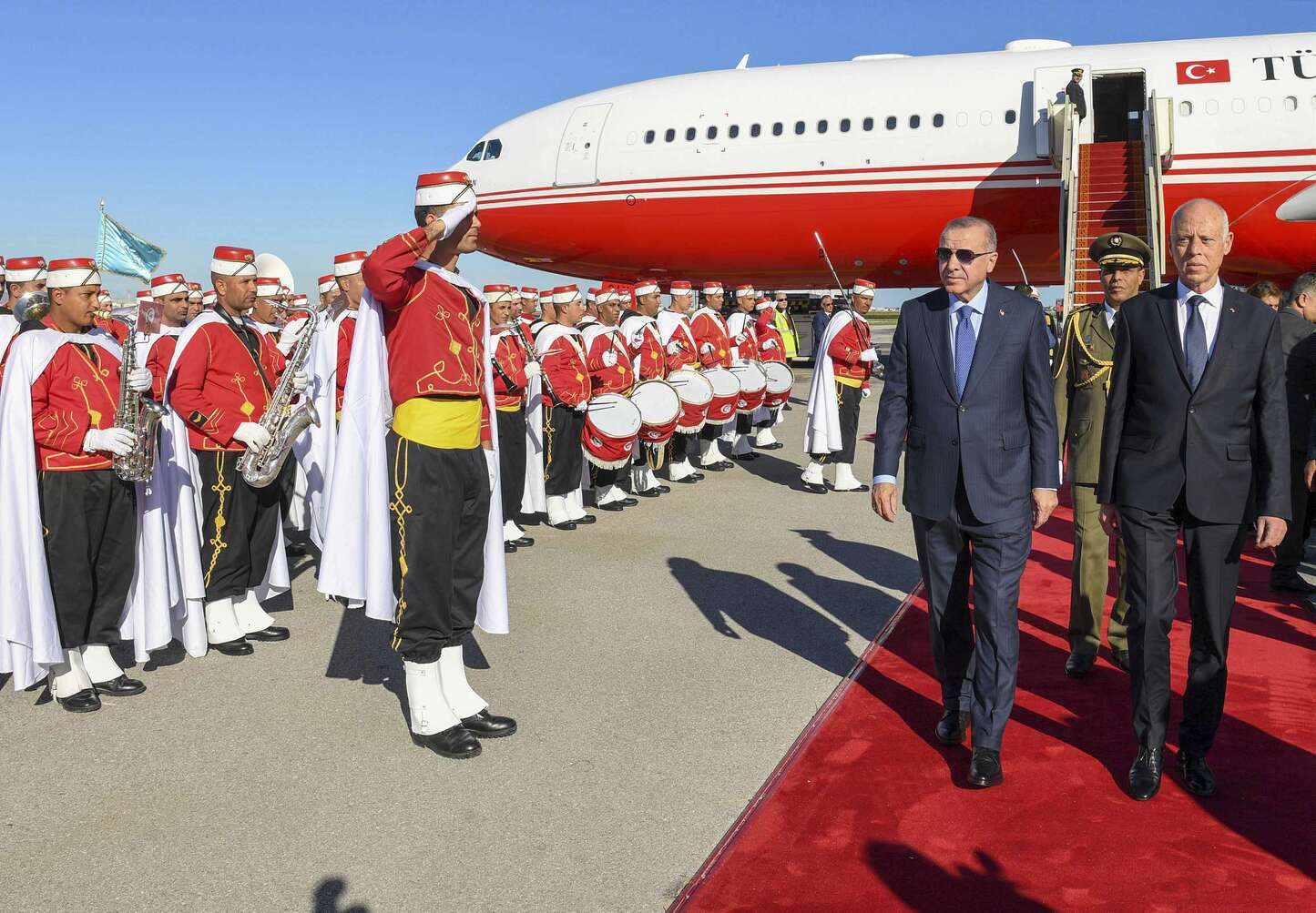 Turkey's President Recep Tayyip Erdogan, left, and Tunisian President Kais Saied, inspect a military honour guard at the airport, in Tunis, Tunisia, Wednesday, Dec. 25, 2019. (AP)