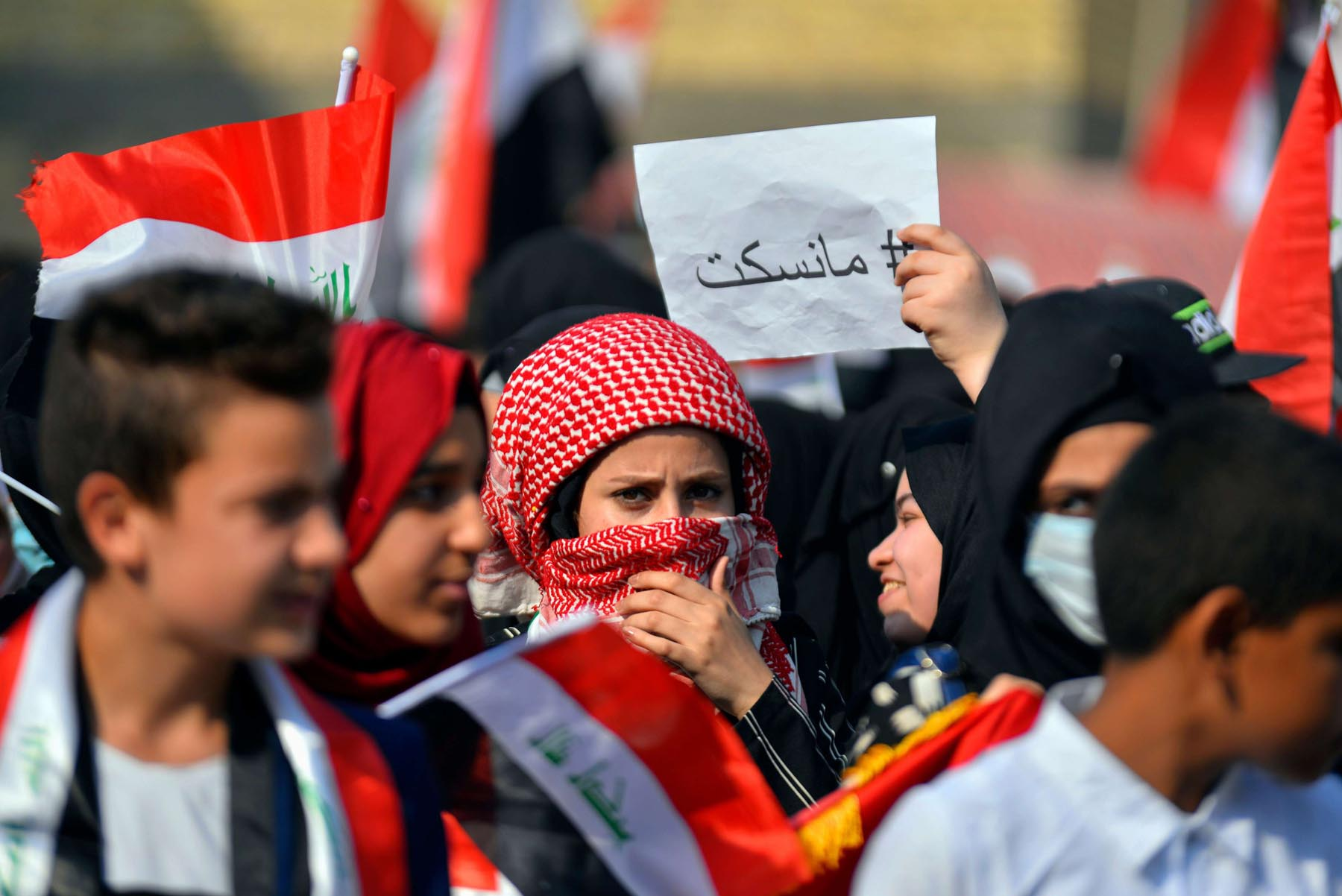 Their patience is over. Iraqi protesters march during anti-government demonstrations in the southern city of Diwaniyah, near the Shia shrine city of Najaf.      (AFP)