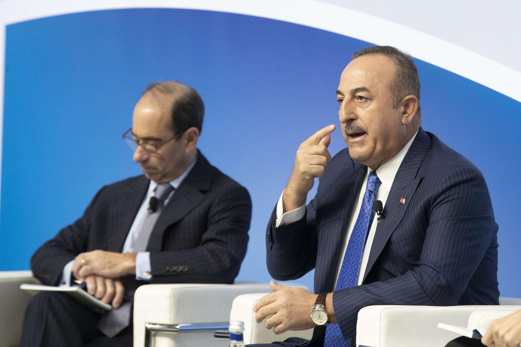 In the public eye. Turkish Minister of Foreign Affairs Mevlut Cavusoglu (R) speaks at the Mediterranean dialogues conference in Rome, December 6. (AP)