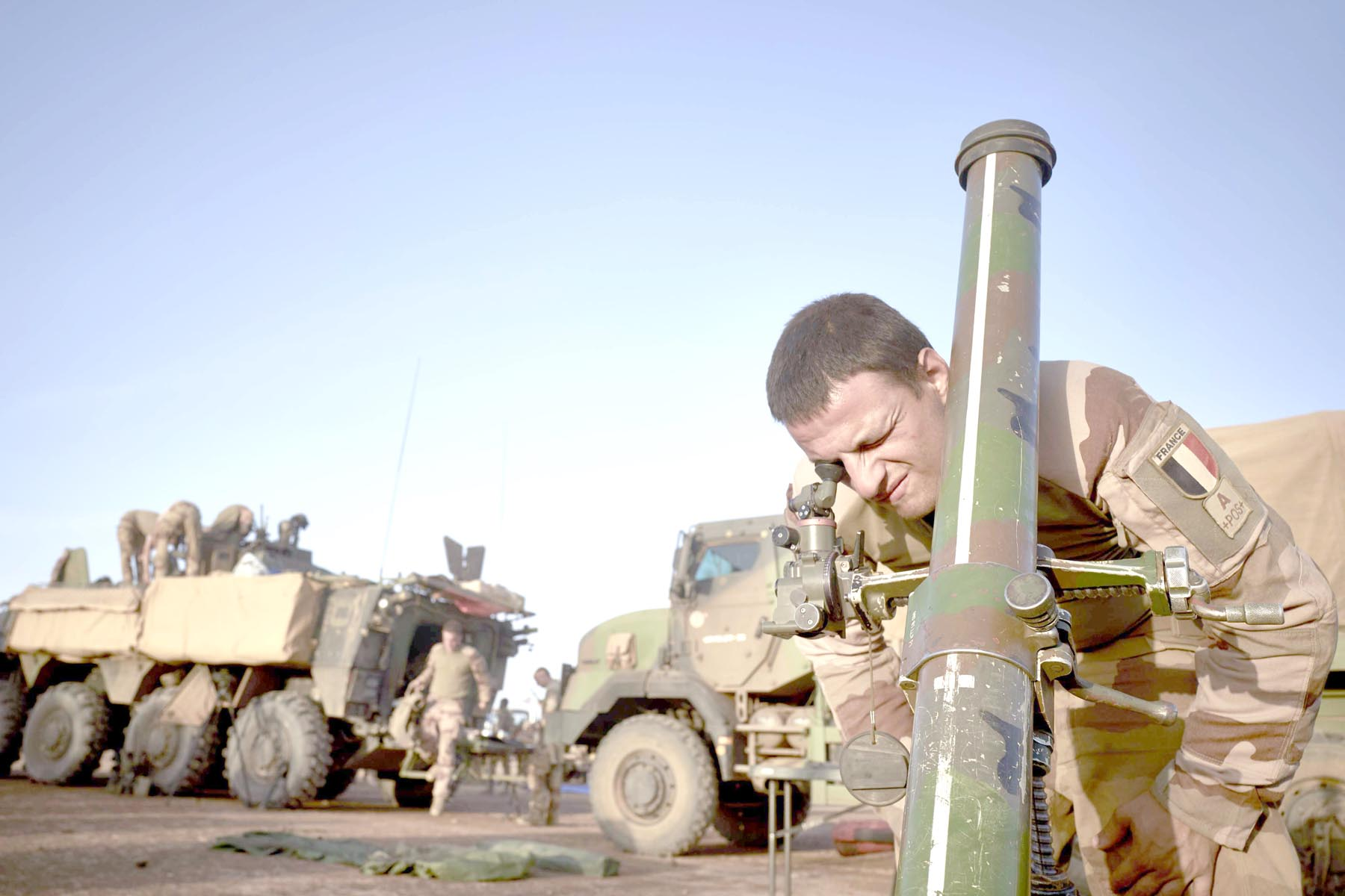 A soldier of the French Army adjusts the coordinates of a mortar ready to be used at a Temporary Operative Advanced Base (BOAT) during the Bourgou IV operation in Northern Burkina Faso, November 10.       (AFP)