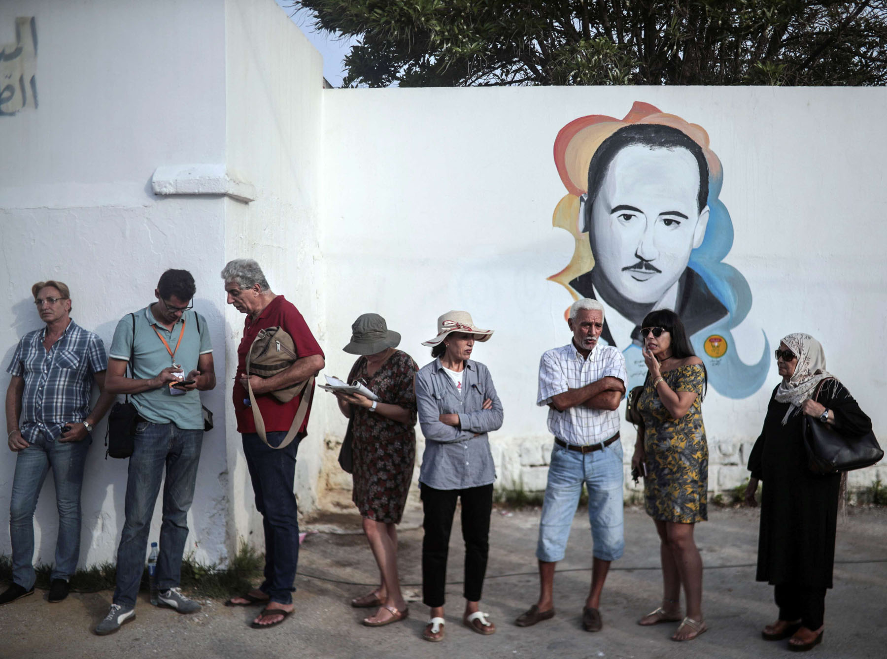 Tunisians queue outside a polling station during the first round of the presidential election, last September.  (AP)