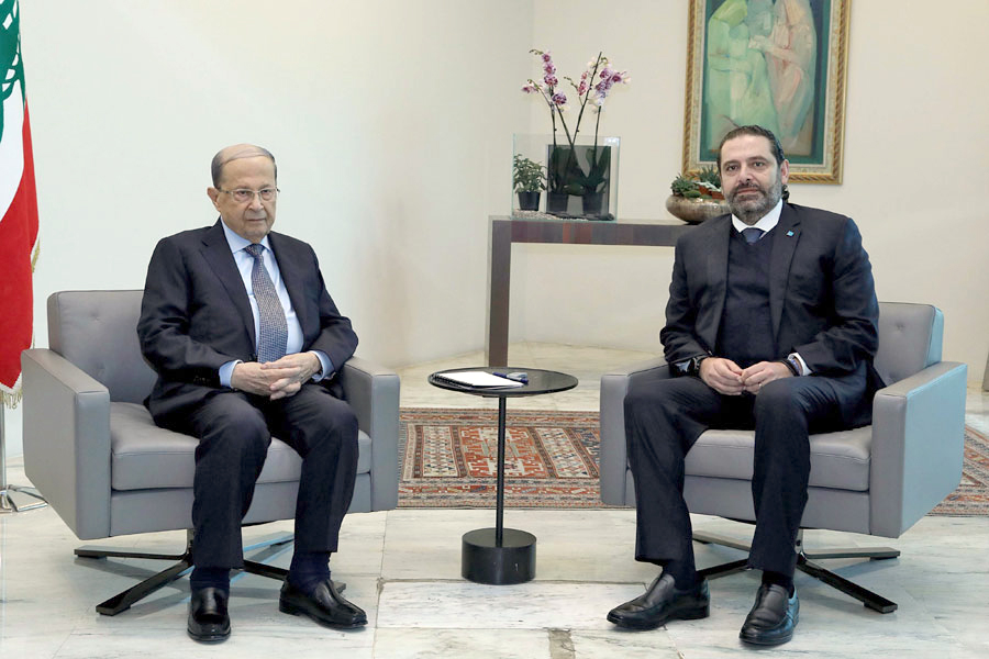 Caught into a vicious circle. Lebanese President Michel Aoun (L) meets with caretaker Prime Minister Saad Hariri at the presidential palace in Baabda, east of Beirut, December 19.  (AFP)