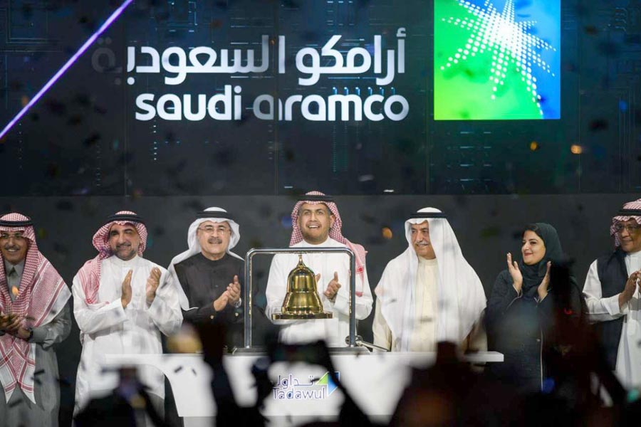 Officials from the state-owned Saudi oil company Aramco and the stock market celebrate during the debut of Aramco on the Riyadh stock exchange, December 11. (SPA)