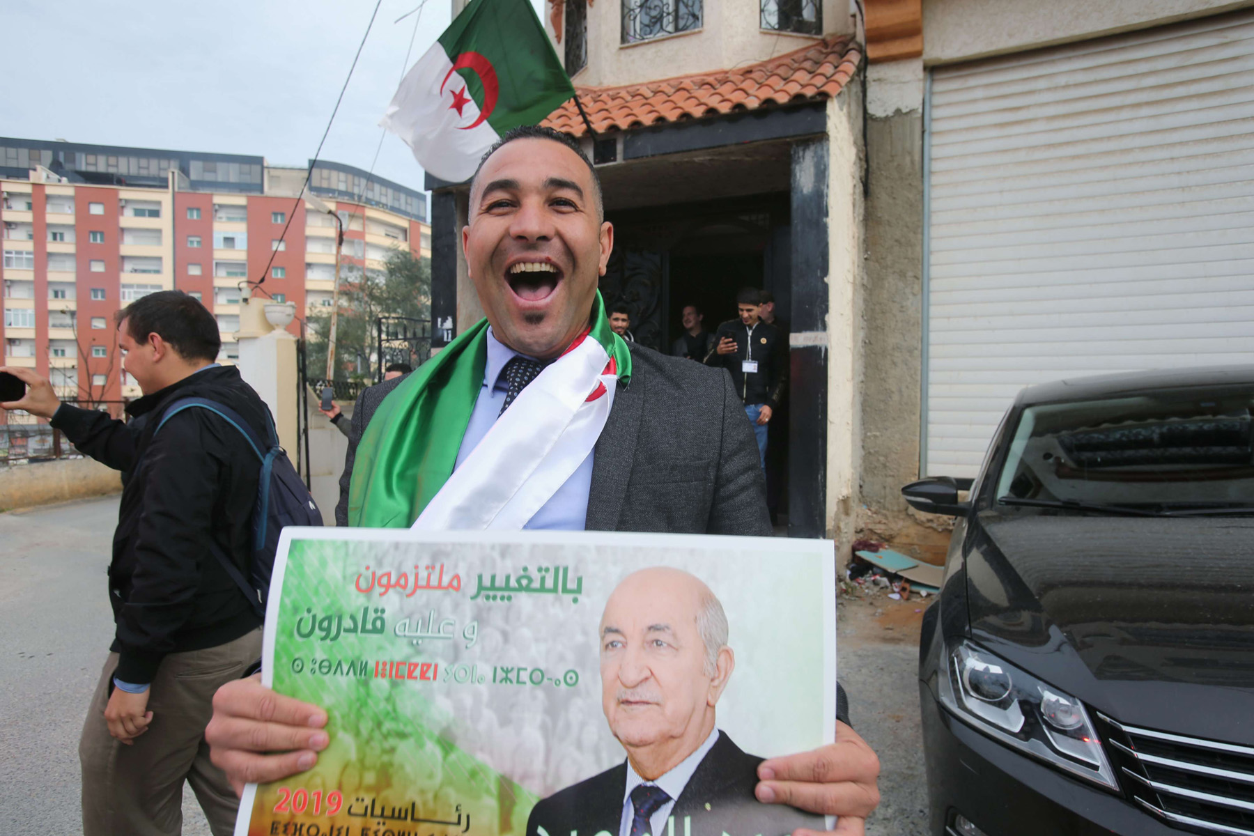 What comes next? A supporter cheers after the annoucement of presidential election results at the campaign headquarters of Abdelmadjid Tebboune in Algiers, December 13.  (Reuters)