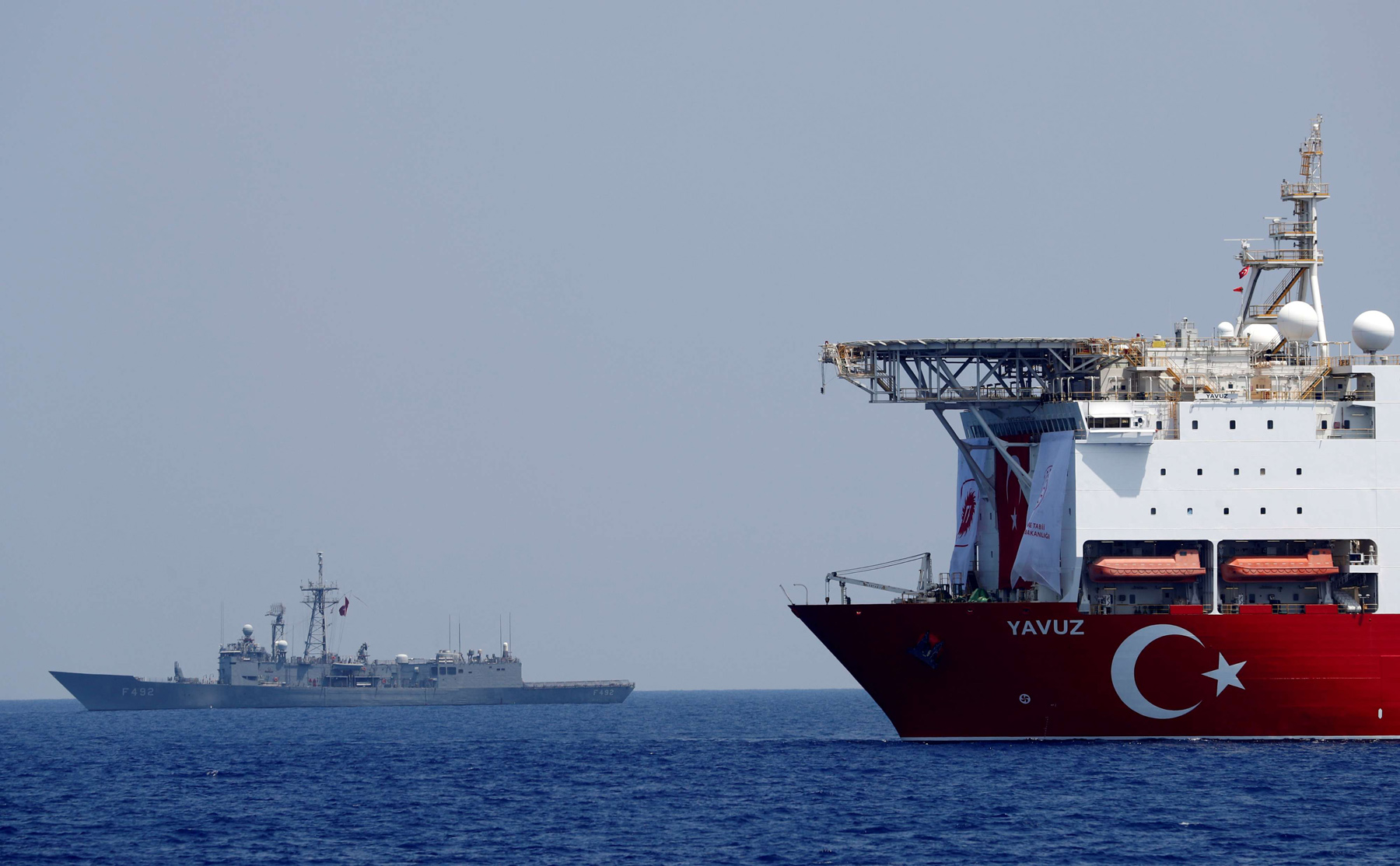 Turbulent waters. Turkish drilling vessel Yavuz is escorted by Turkish Navy frigate TCG Gemlik (F-492) in the eastern Mediterranean Sea off Cyprus. (Reuters)