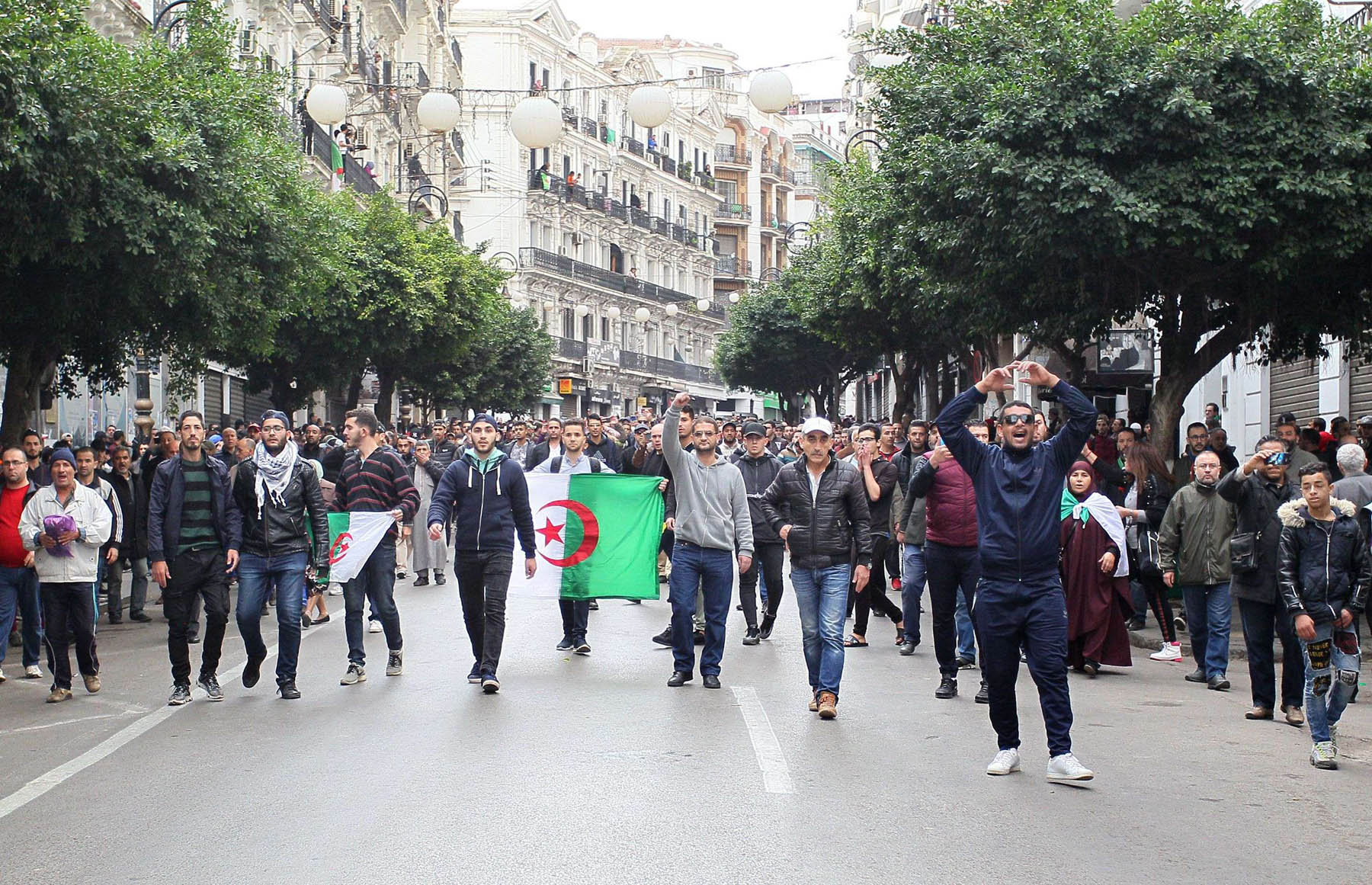 Algerian protesters take part in an anti-government demonstration in the capital Algiers on December 12 during the presidential election. (AFP)