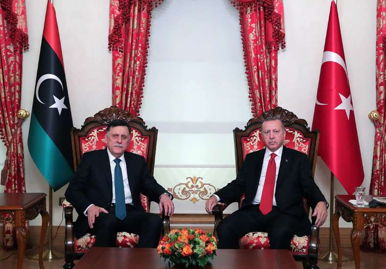 Turkish President Recep Tayyip Erdogan (R) meets with Chairman of the Presidential Council of Libya Fayez al-Sarraj at the Dolmabahce Palace, November 27. (DPA)