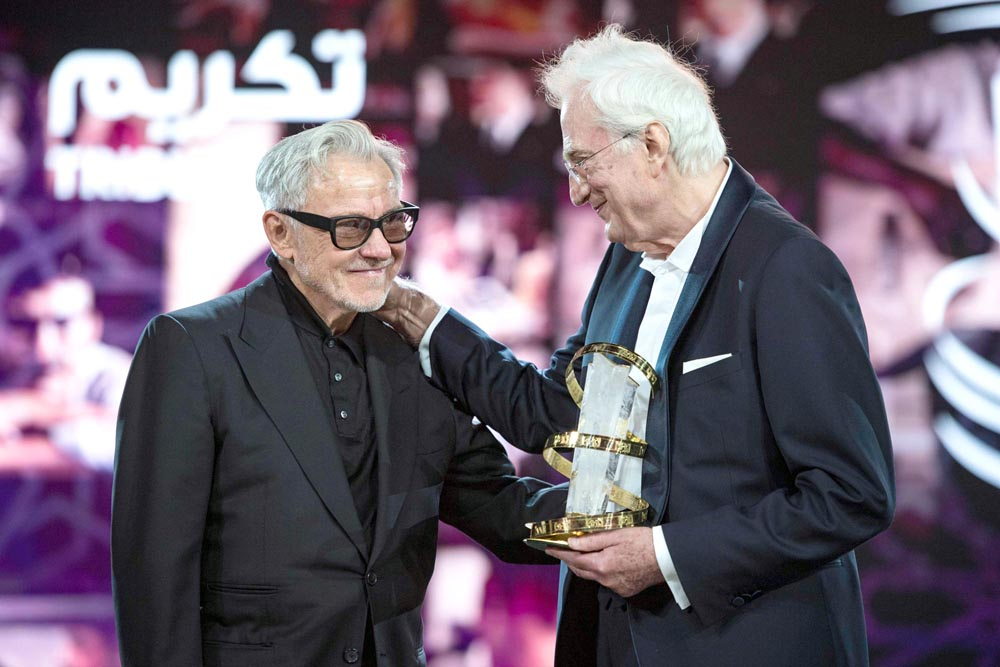 French director Bertrand Tavernier (R) is presented with the Etoile d'Or by US actor Harvey Keitel during the Marrakech International Film Festival, December 1. (AFP)