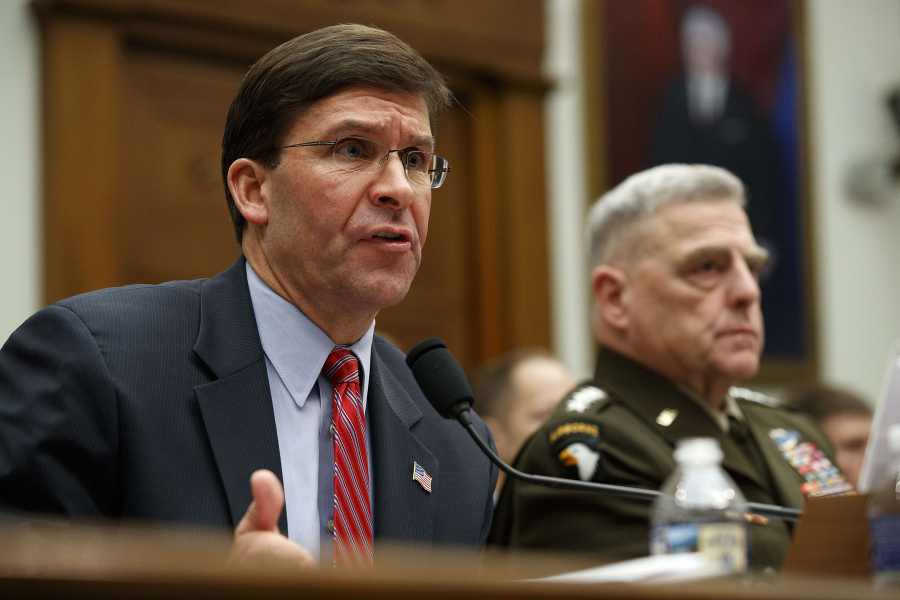 US Secretary of Defence Mark Esper (L) and Chairman of the Joint Chiefs General Mark Milley testify to a US House committee hearing on US policy in Syria, December 11, on Capitol Hill in Washington. (AP)