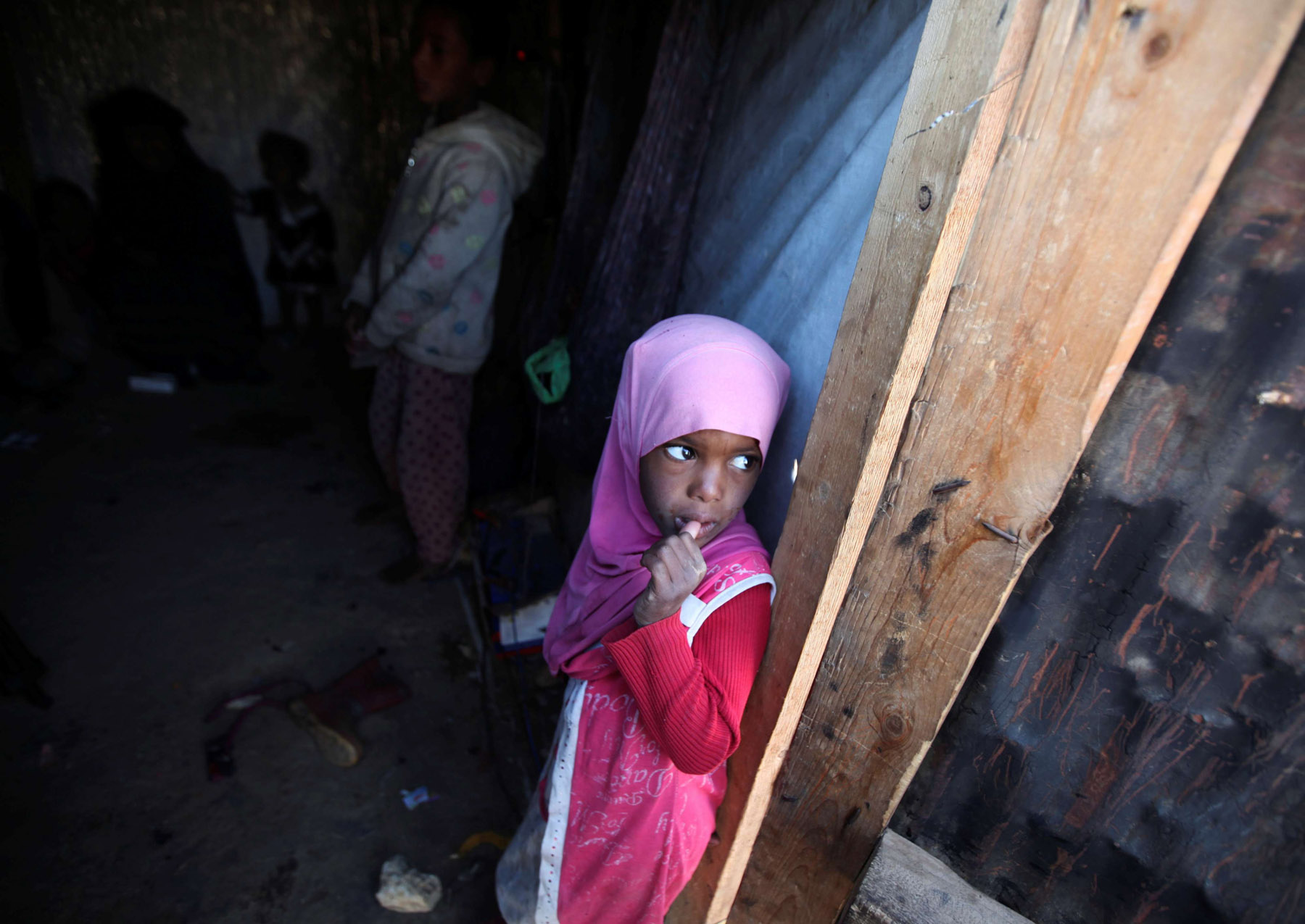A girl stands in her family's hut at a camp for internally displaced people in Khamir of the northwestern province of Amran. (Reuters)