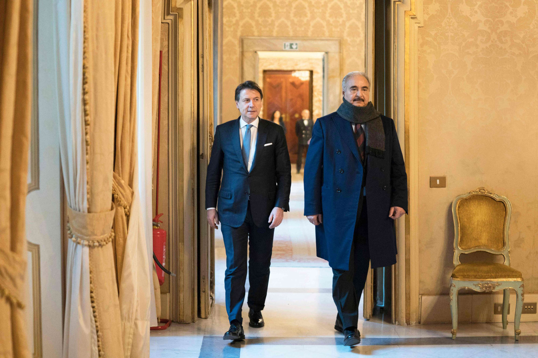 Unchanged course. Italy's Prime Minister Giuseppe Conte (L) and Libya's military strongman Khalifa Haftar at Palazzo Chigi in downtown Rome for a meeting as part of Europe's accelerating diplomatic efforts to seek ways to ease crisis, January 8.             (AFP)