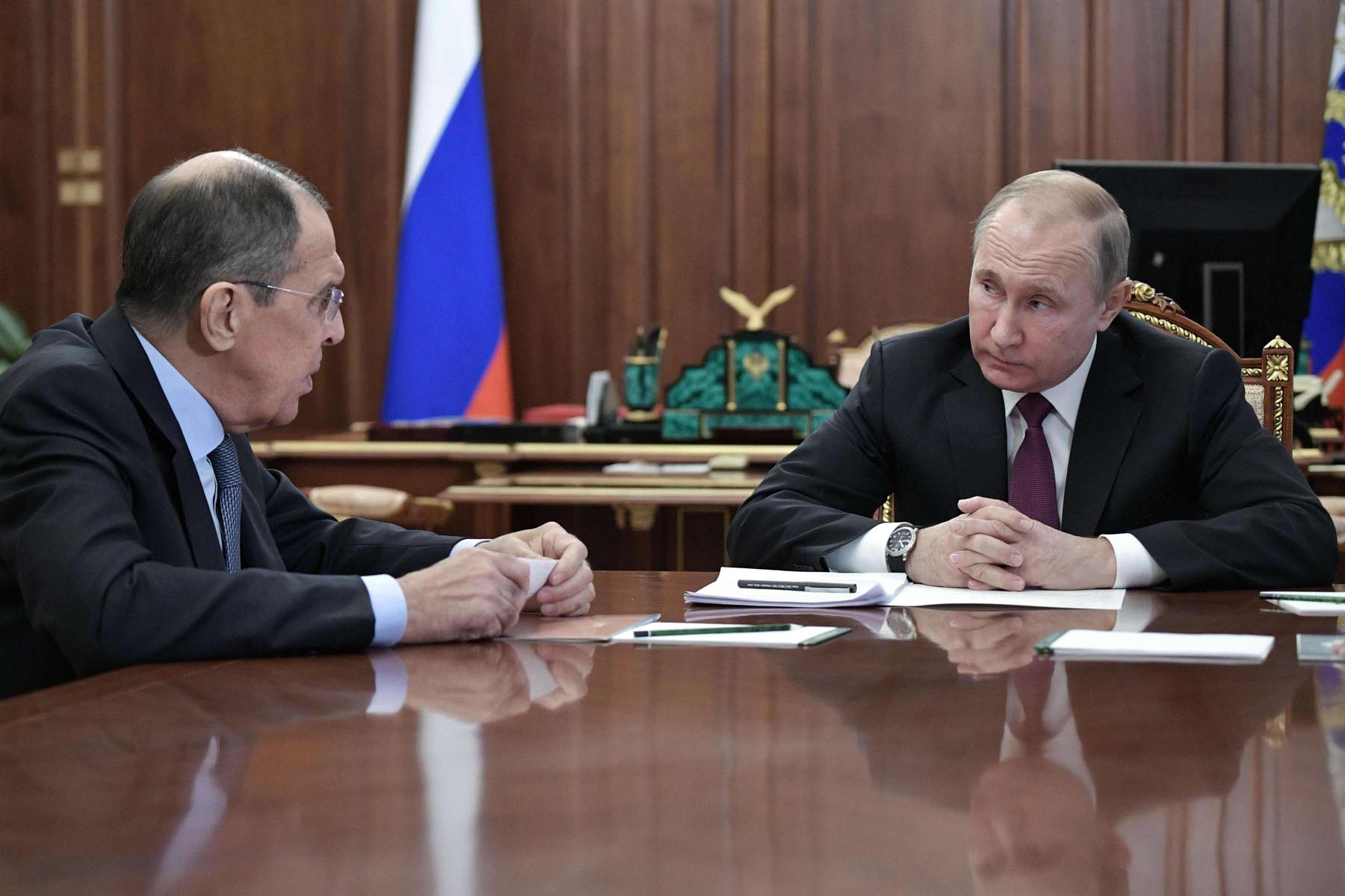 Russia's President Vladimir Putin (R) attends a meeting with Foreign Minister Sergei Lavrov in Moscow, last February. (AFP)
