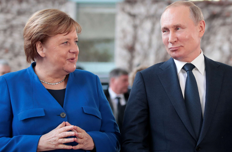 German Chancellor Angela Merkel and Russian President Vladimir Putin attend the Libya summit in Berlin, January 19. (Reuters)