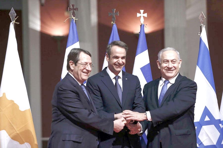 Greek Prime Minister Kyriakos Mitsotakis (C), Cypriot President Nicos Anastasiadis (L) and Israeli Prime  Minister Binyamin Netanyahu pose for a photograph ahead of a  signing ceremony in Athens, January 2. 	                                    (AP)