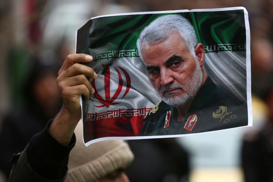 An Iranian holds a picture of slain General Qassem Soleimani in Tehran, January 4. (WANA via Reuters)