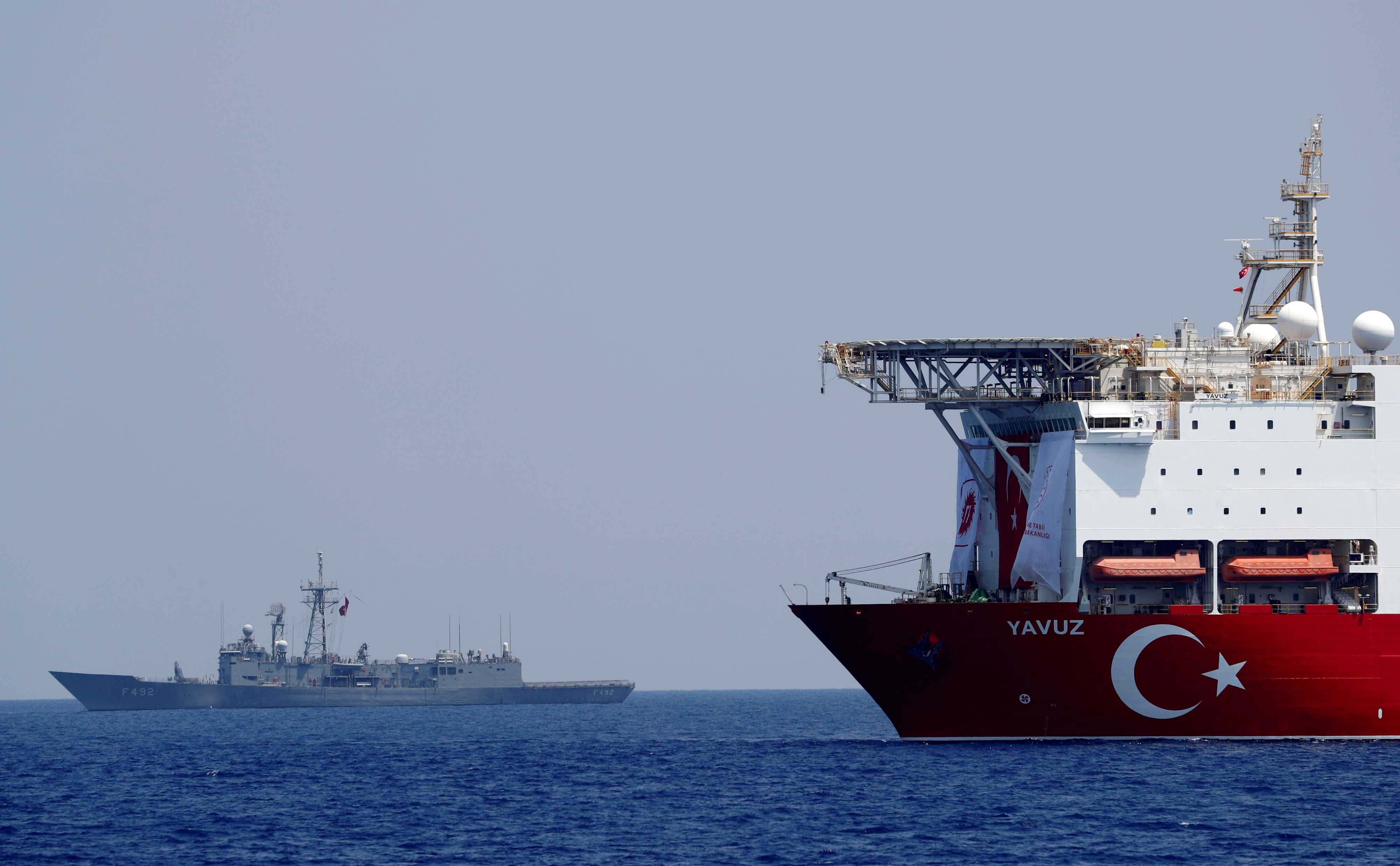 Grab for riches. Turkish drilling vessel Yavuz is escorted by a Turkish Navy frigate in the eastern Mediterranean Sea off Cyprus, last August. (Reuters)