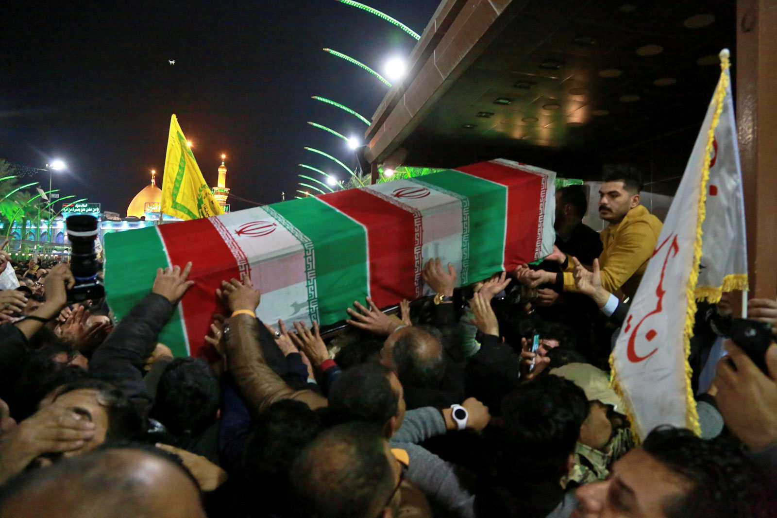 Mourners carry the coffins of Iran's top general Qassem Soleimani during their funeral in Karbala, Iraq, Saturday, Jan. 4, 2020. (AP)