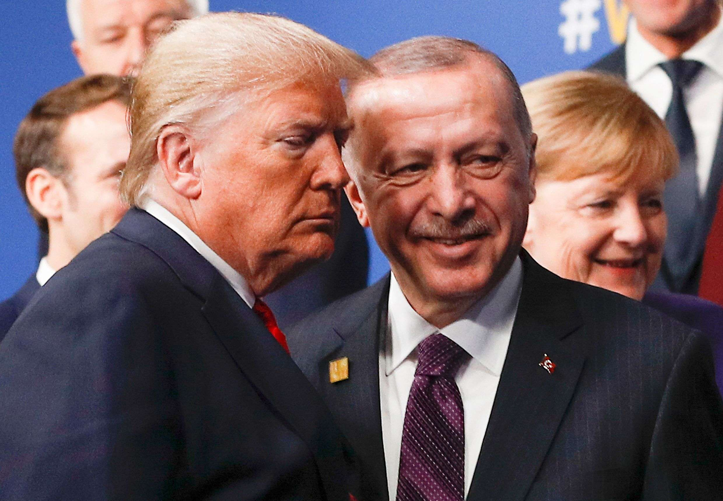 In this file photo taken on December 4, 2019 US President Donald Trump (L) and Turkey's President Recep Tayyip Erdogan leave the stage after the family photo to head to the plenary session at the NATO summit at the Grove hotel in Watford, London. (AFP)