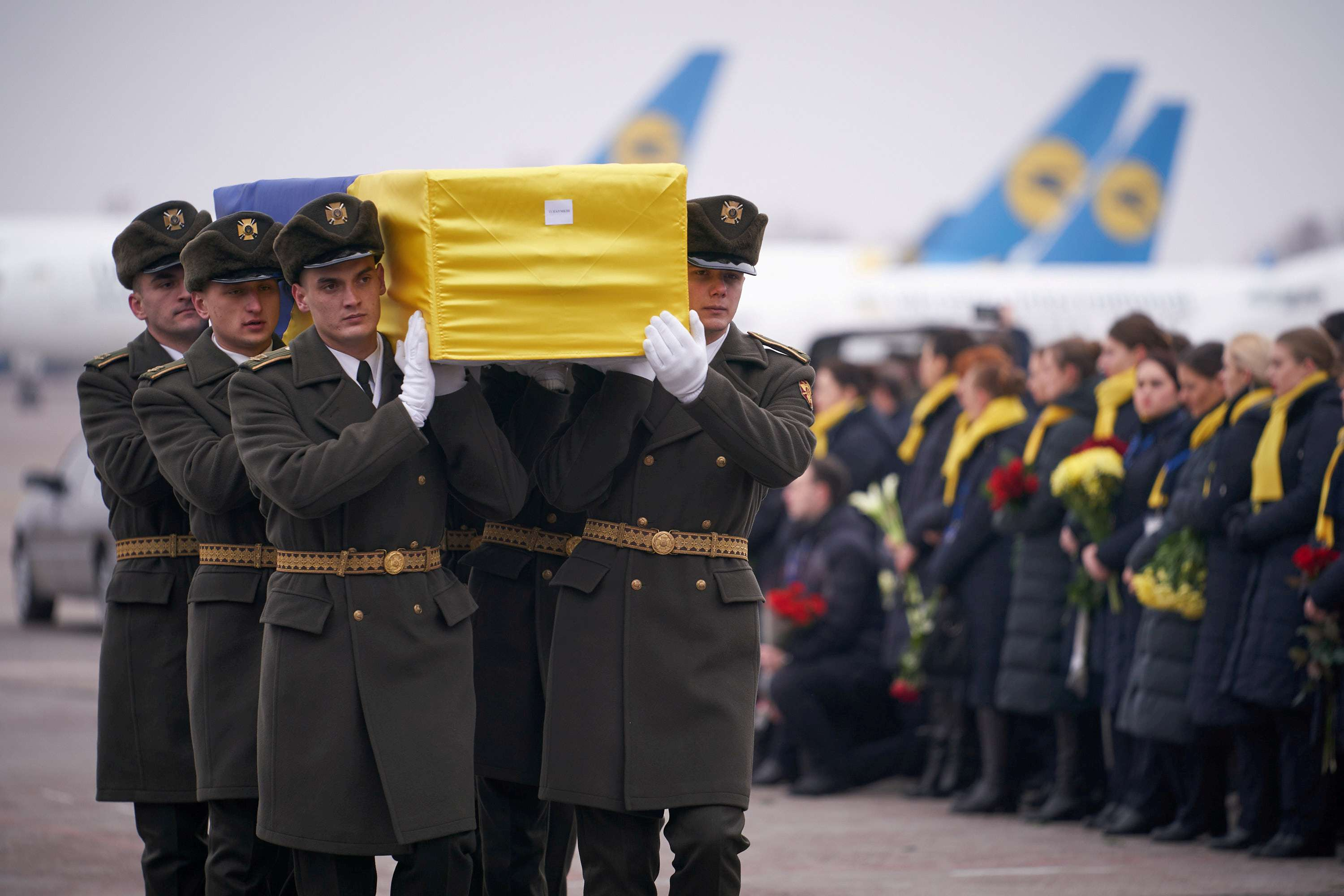 Inexcusable. Ukrainian soldiers carry a coffin containing the remains of one of the victims of the Ukraine International Airlines flight 752 plane disaster at the Boryspil International Airport, outside Kiev, Ukraine, January 19, 2020. (Reuters)