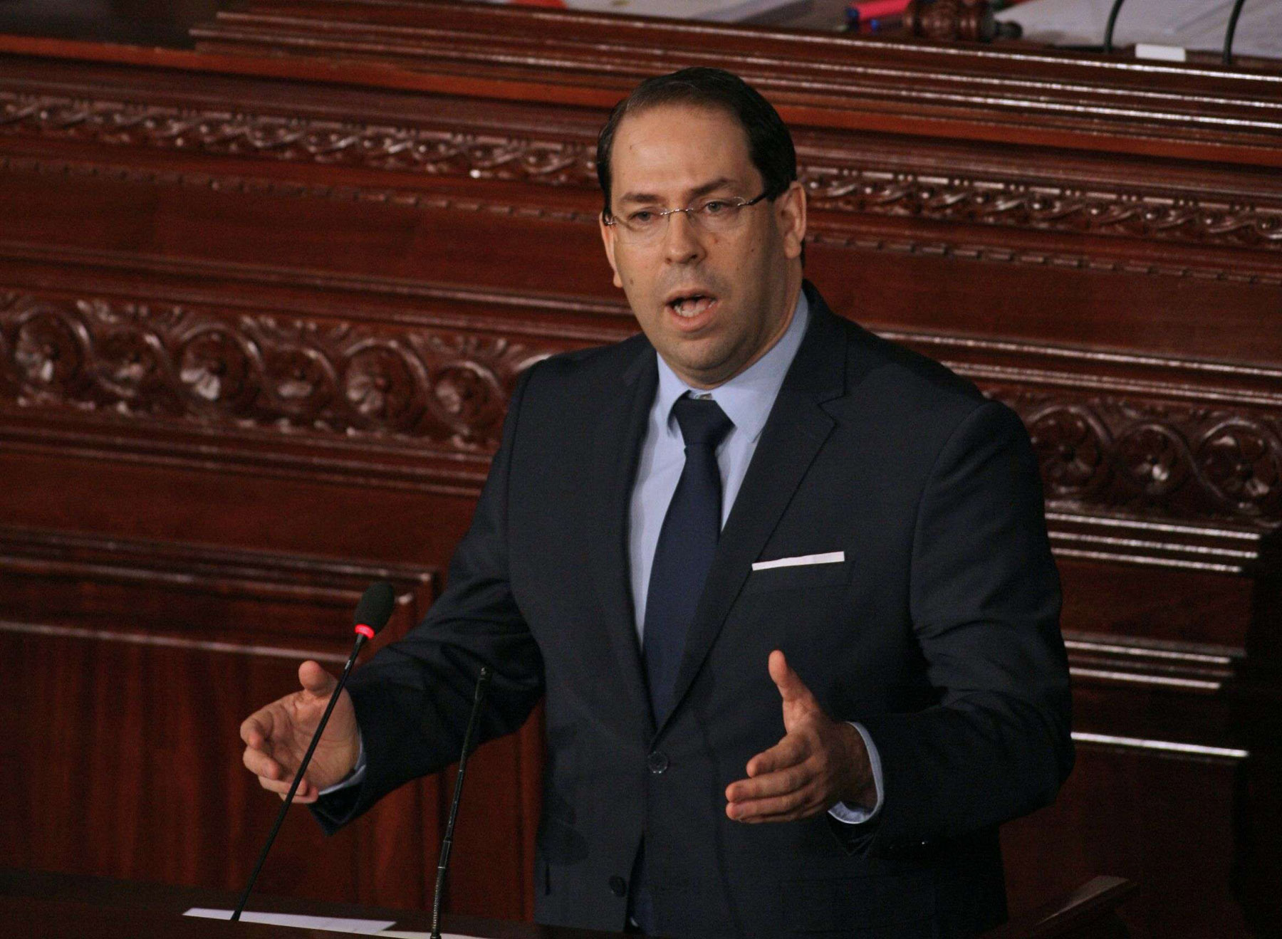 In this file photo taken on March 23, 2018 Tunisian Prime Minister Youssef Chahed addresses parliament during a session in the capital Tunis, amidst calls to reshuffle government. (AFP)
