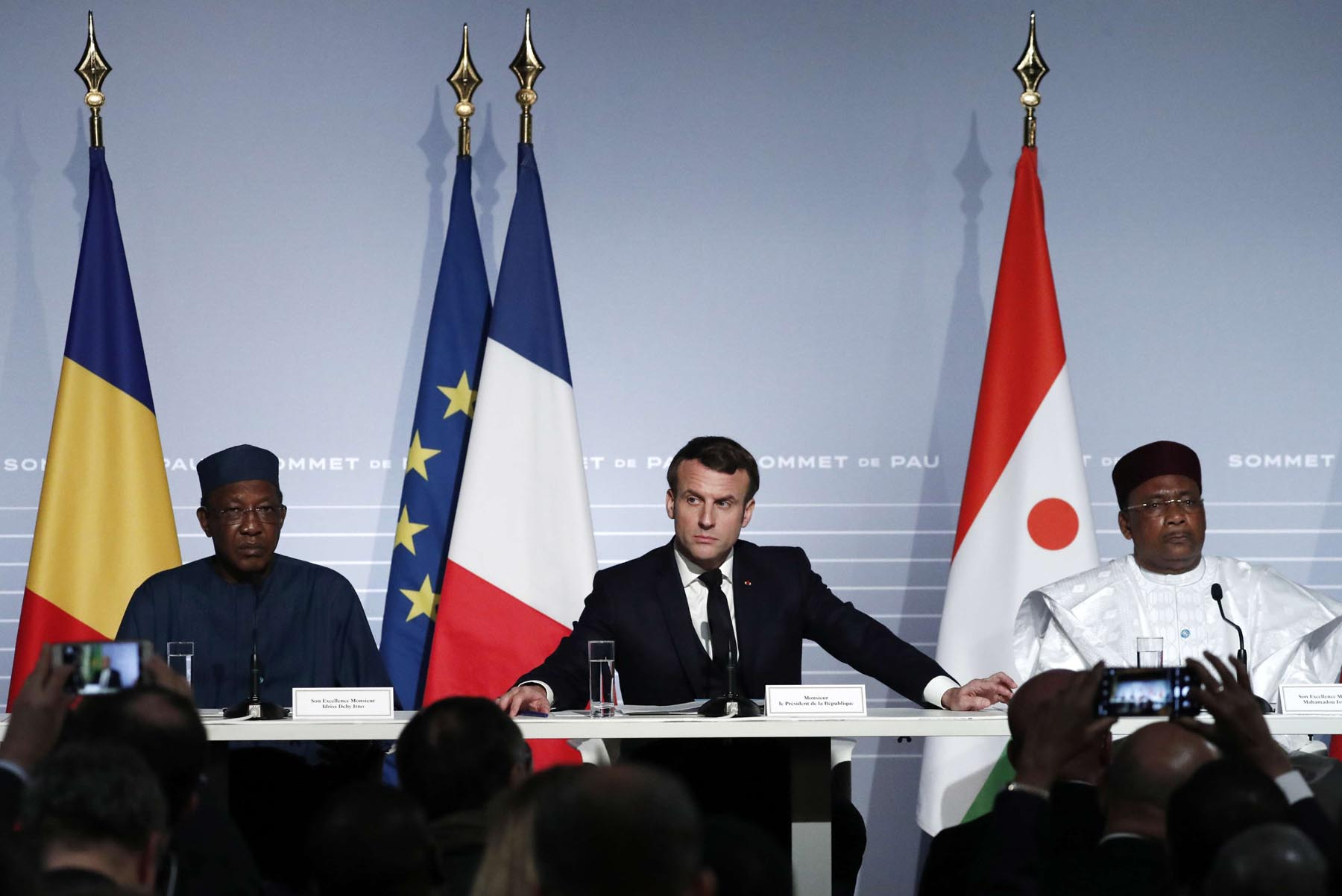 Serious risks. France's President Emmanuel Macron, Niger President Mahamadou Issoufou and Chad's President Idriss Deby at a news conference on the G5 Sahel summit in Pau, France, January 13. REUTERS