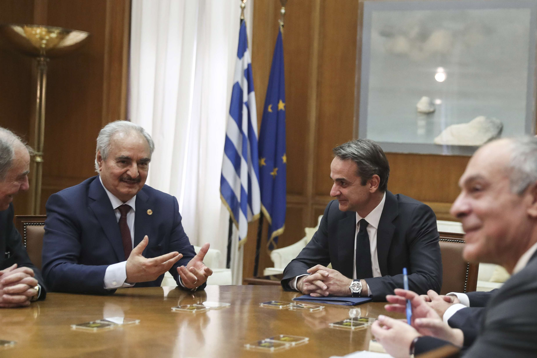 Greek Prime Minister Kyriakos Mitsotakis (2nd R) meets with Libyan National Army Field-Marshal Khalifa Hafter (2nd L) in Athens, January 17. (AP)