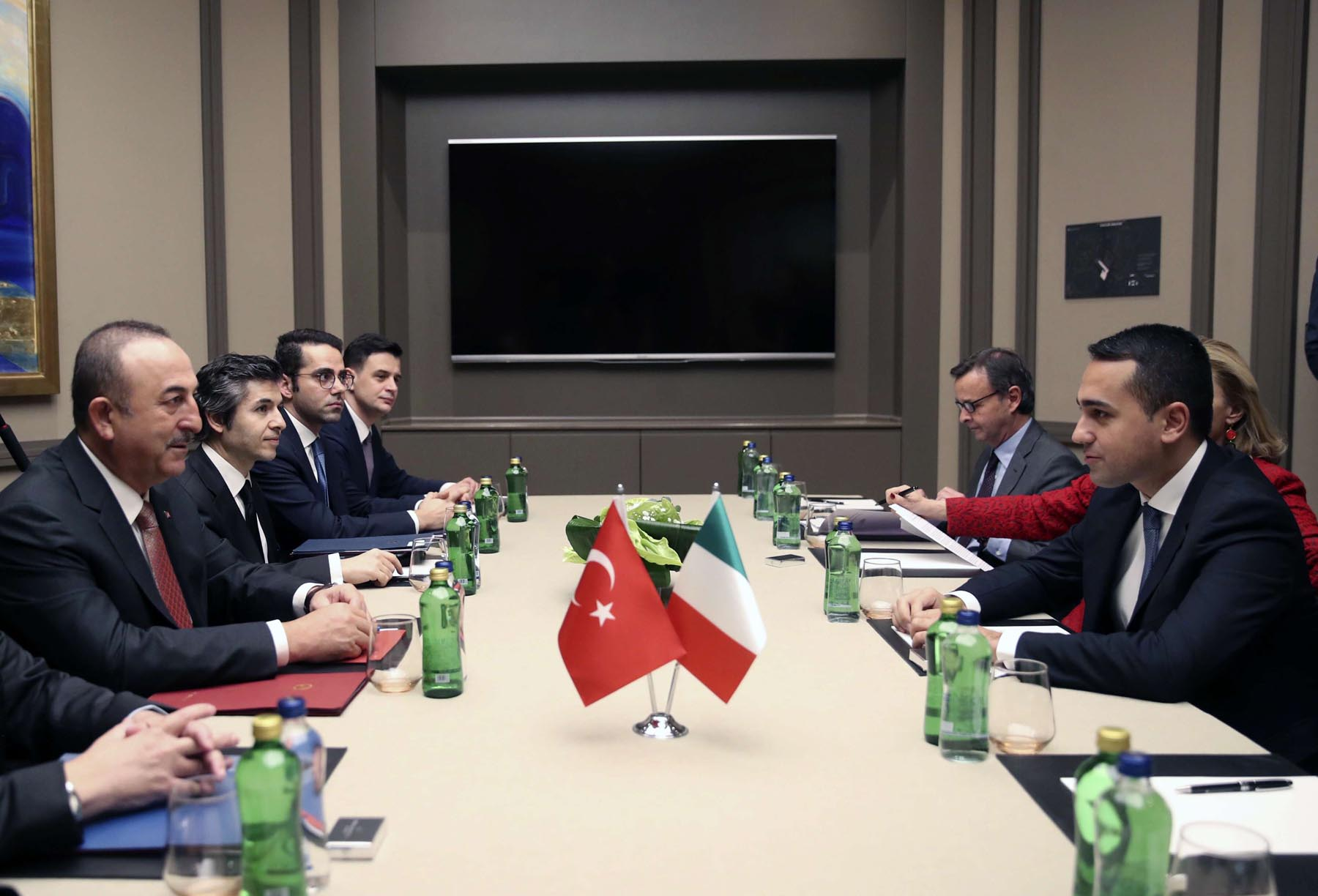 Turkey's Foreign Minister Mevlut Cavusoglu, left, and Italy's Foreign Minister Luigi Di Maio speak during a meeting, in Istanbul, late Tuesday, Jan. 7, 2020. The two expected to discuss the situation in Libya and Eastern Mediterranean.(Fatih Aktas/Turkish Foreign Ministry via AP, Pool)