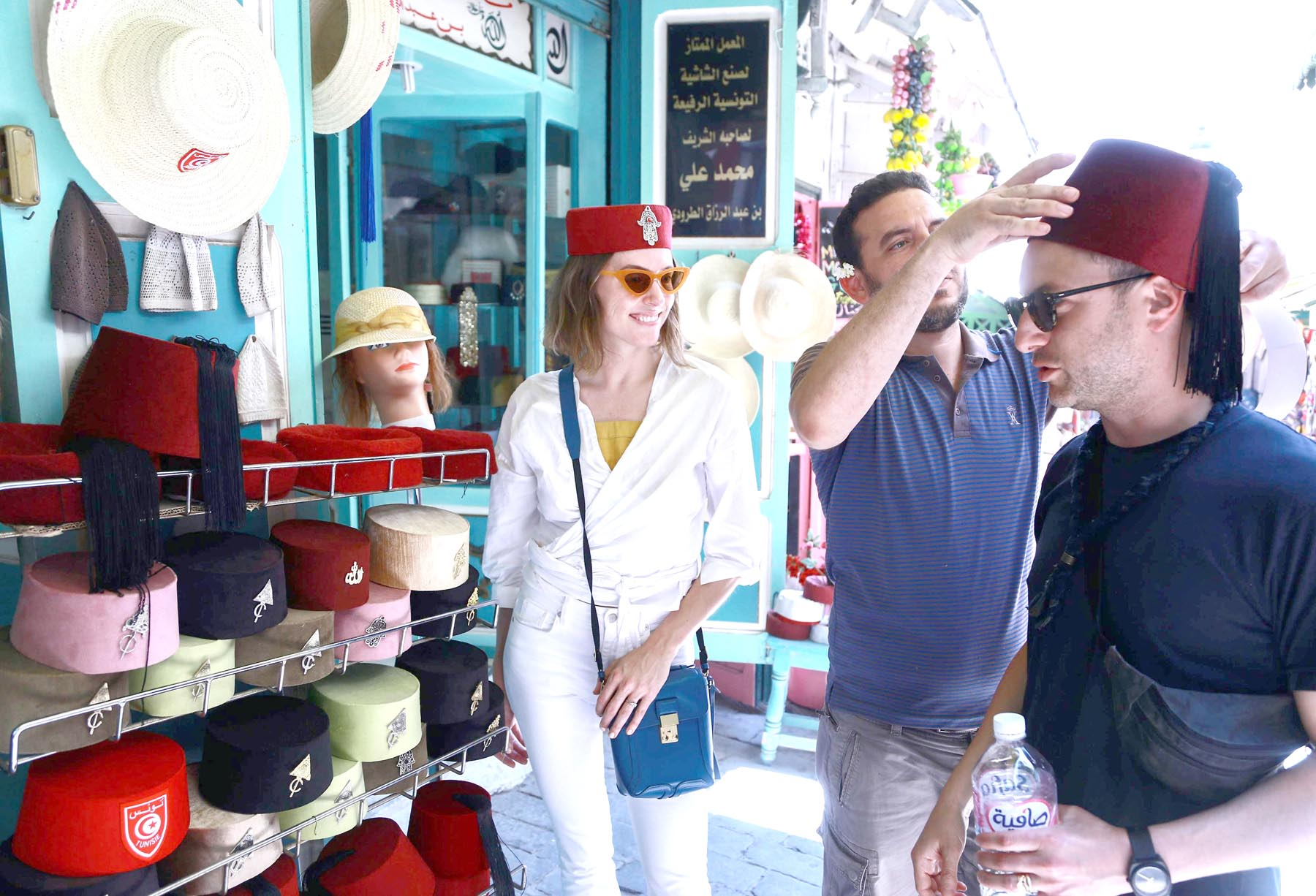 "Welcome trend. A tourist tries on a Tunisian ""chechia"" (traditional fez) in a shop at a bazaar in the Medina (old town) of Tunis, last June.       (AFP)"