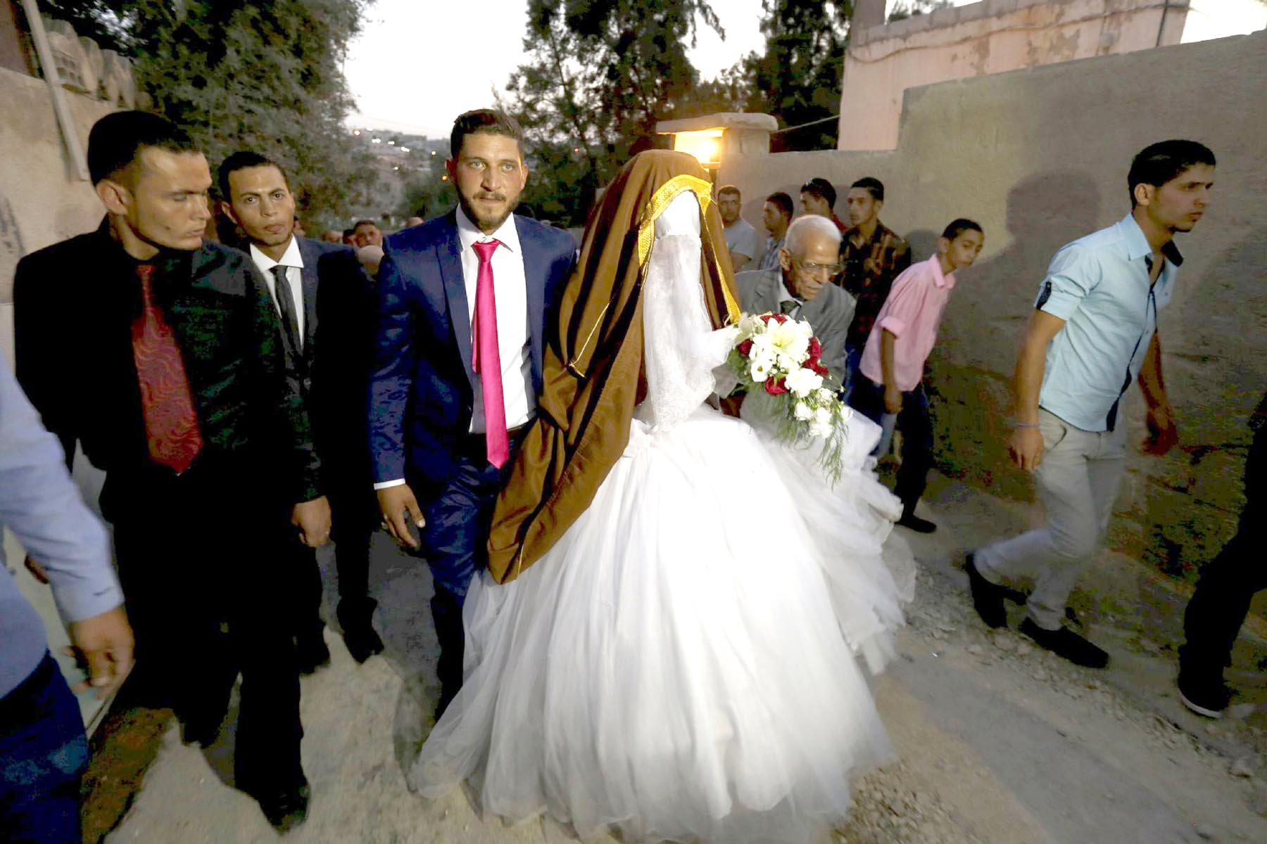 A Jordanian couple on their wedding day in Zarqa, east of Amman.	(Reuters)