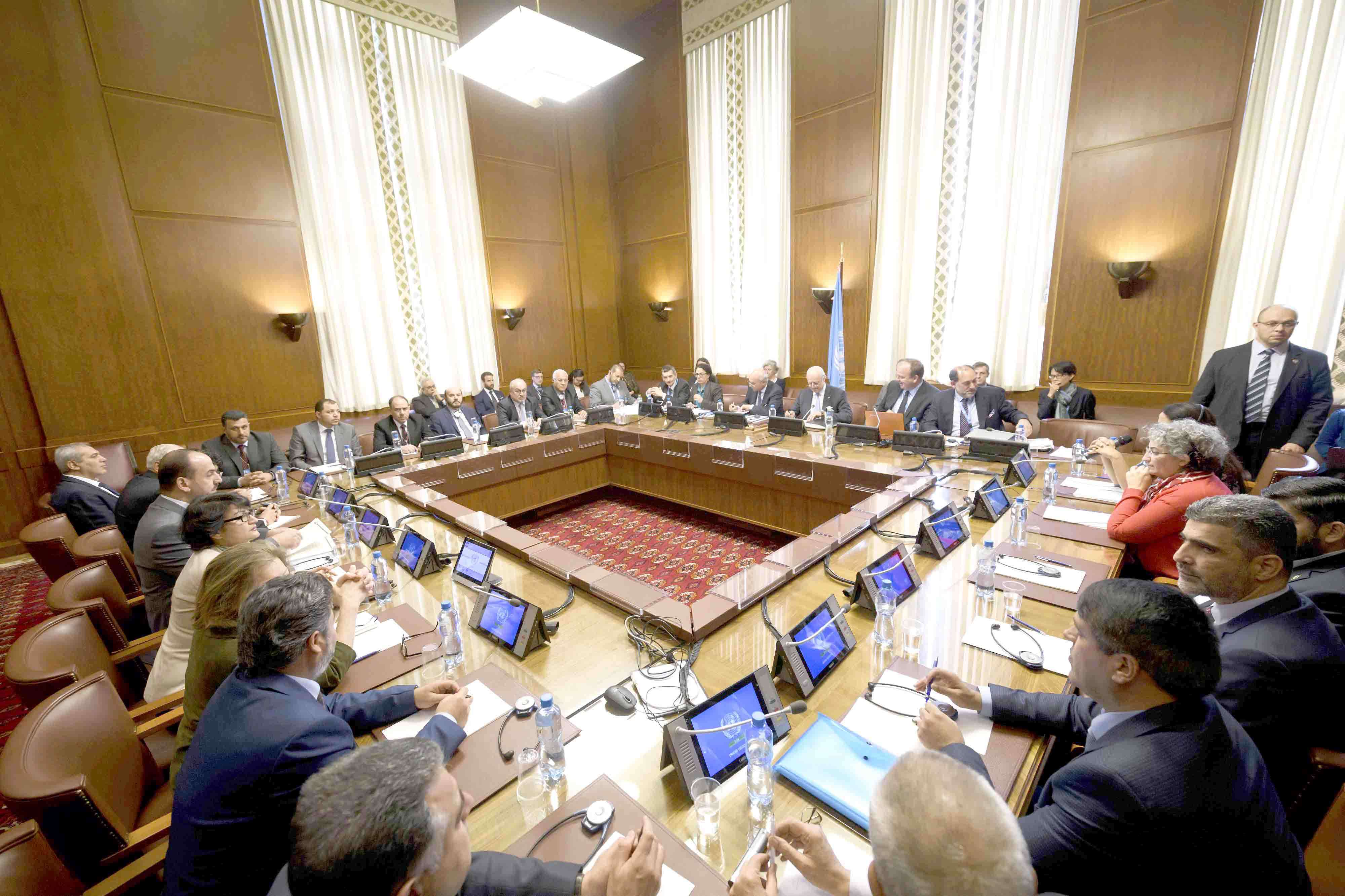 A 2017 file photo shows a meeting of a delegation of Syria's main opposition High Negotiations Committee with the UN special envoy for Syria during peace talks in Geneva. (AFP)