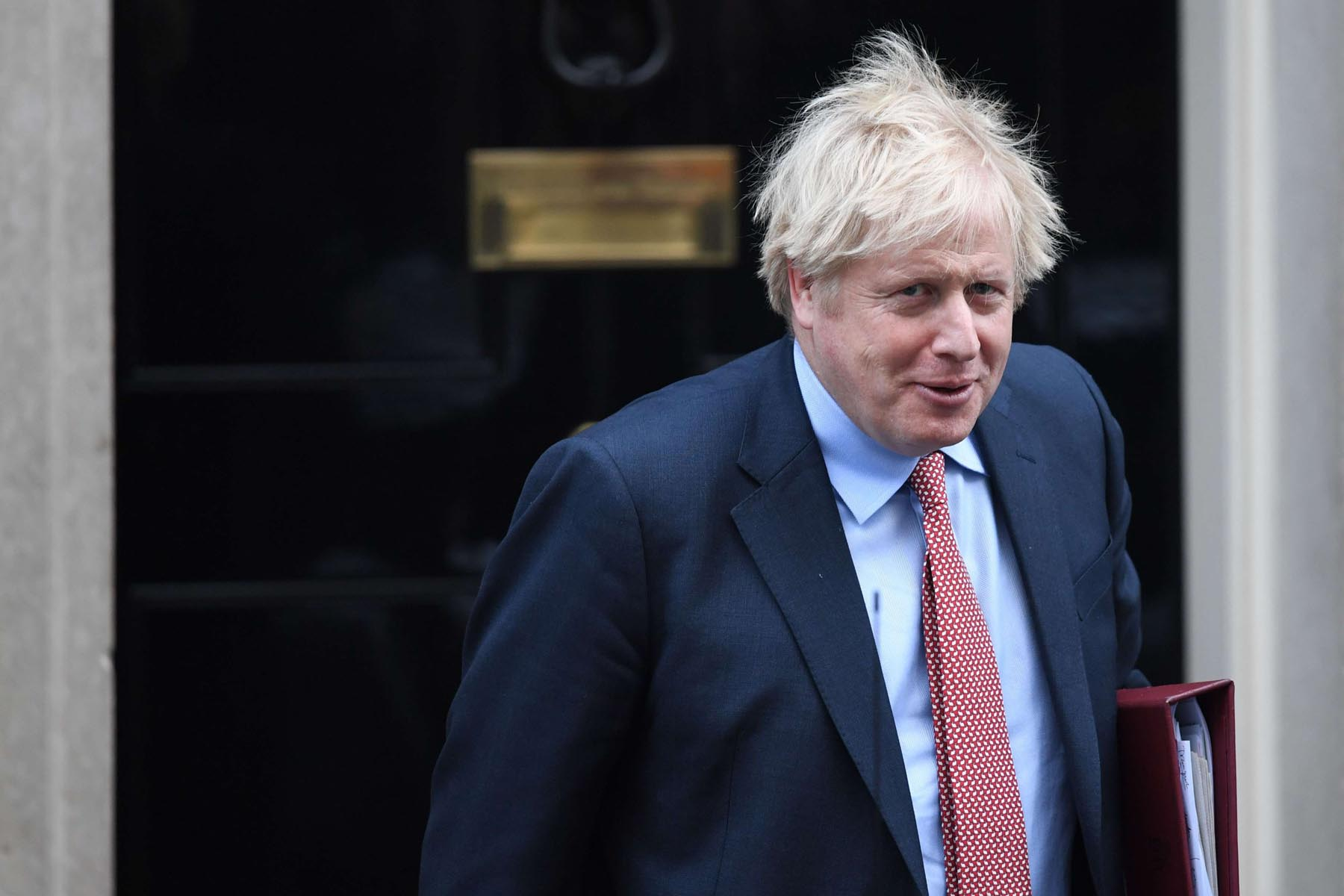 New phase. Britain's Prime Minister Boris Johnson leaves 10 Downing Street in central London, January 29.    (AFP)