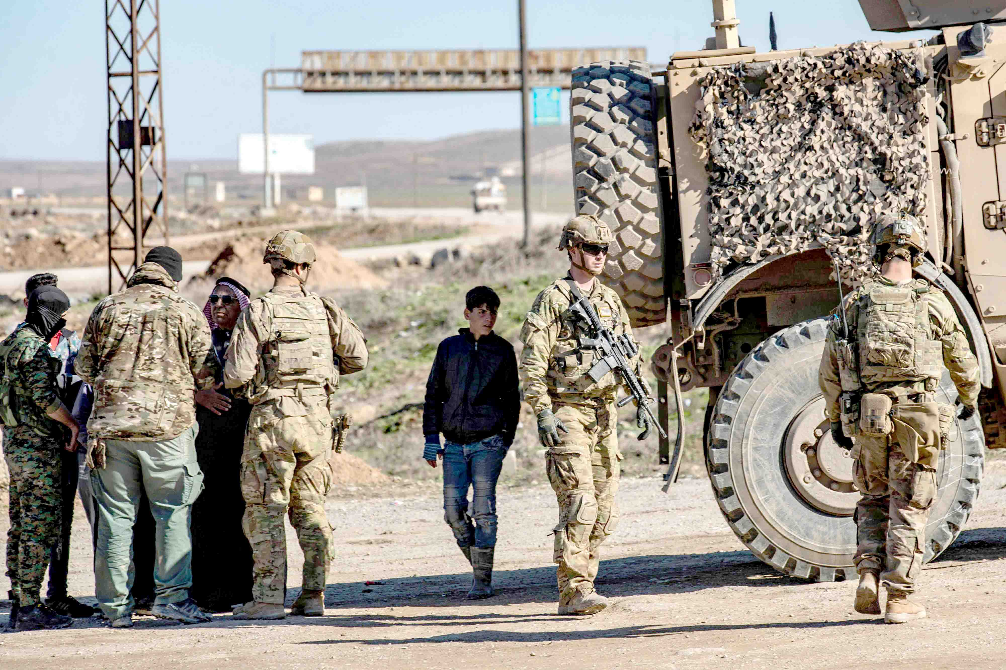 US soldiers patrol a road in the town of Tal Tamr in the Syrian Hasakah province, January 26. (AFP)