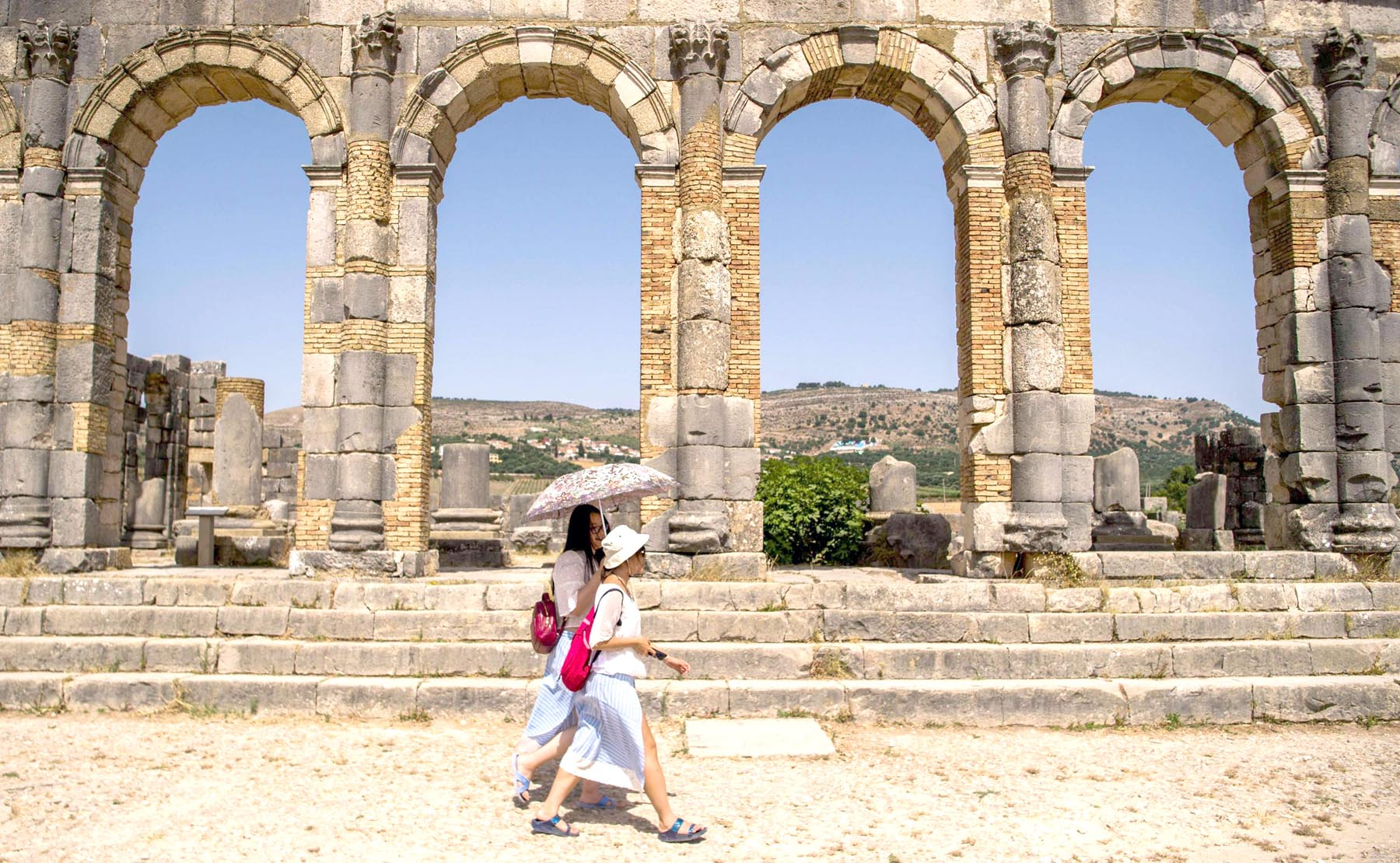 Tourists walk through the ruins of the ancient Roman site of Volubilis, near the town of Moulay Idriss Zerhounon in Morocco's north central Meknes region.  	  (AFP)