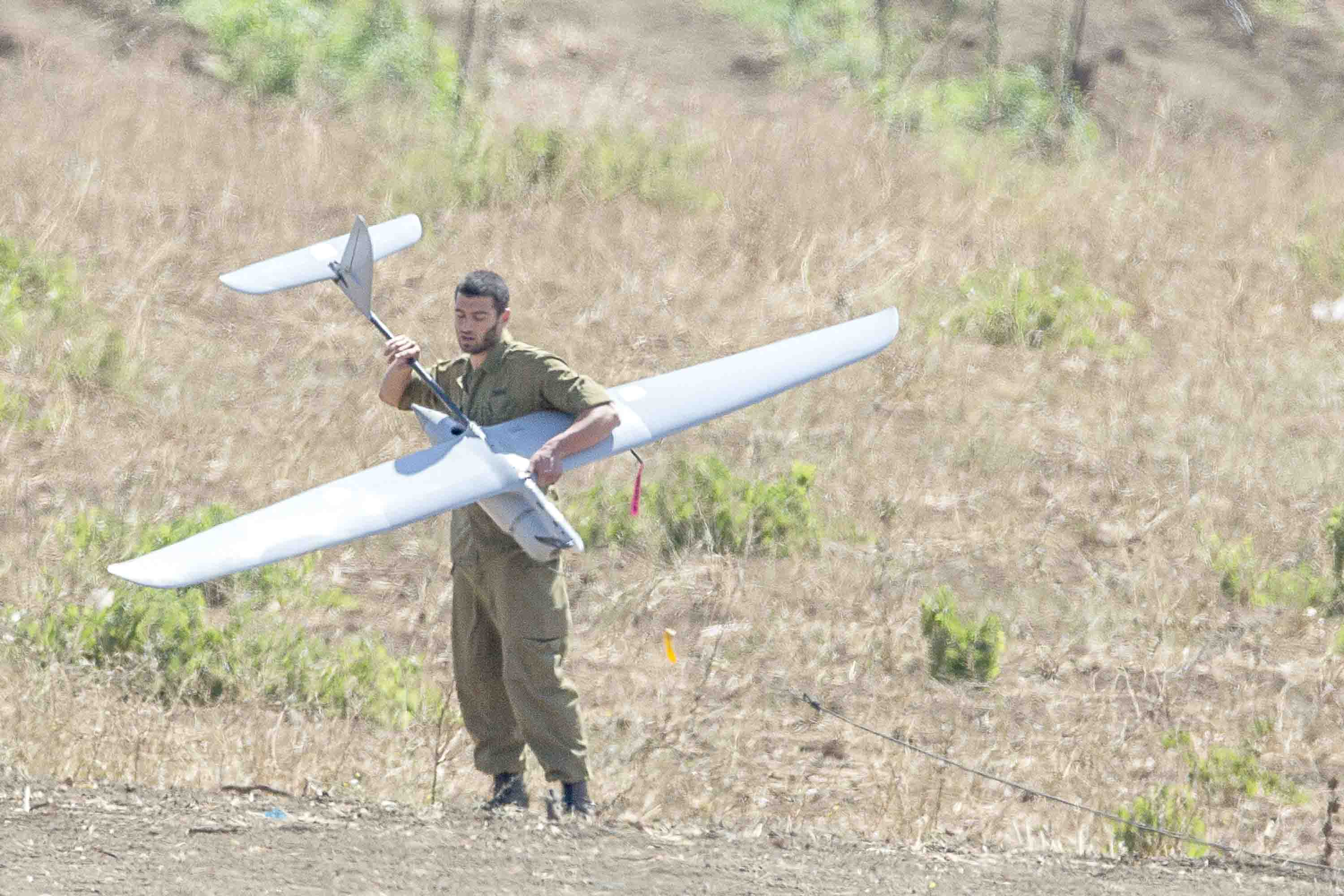 An Israeli soldier launches an unmanned aerial drone near the Quneitra crossing, the only border crossing with Syria in the Golan Heights. (AFP)