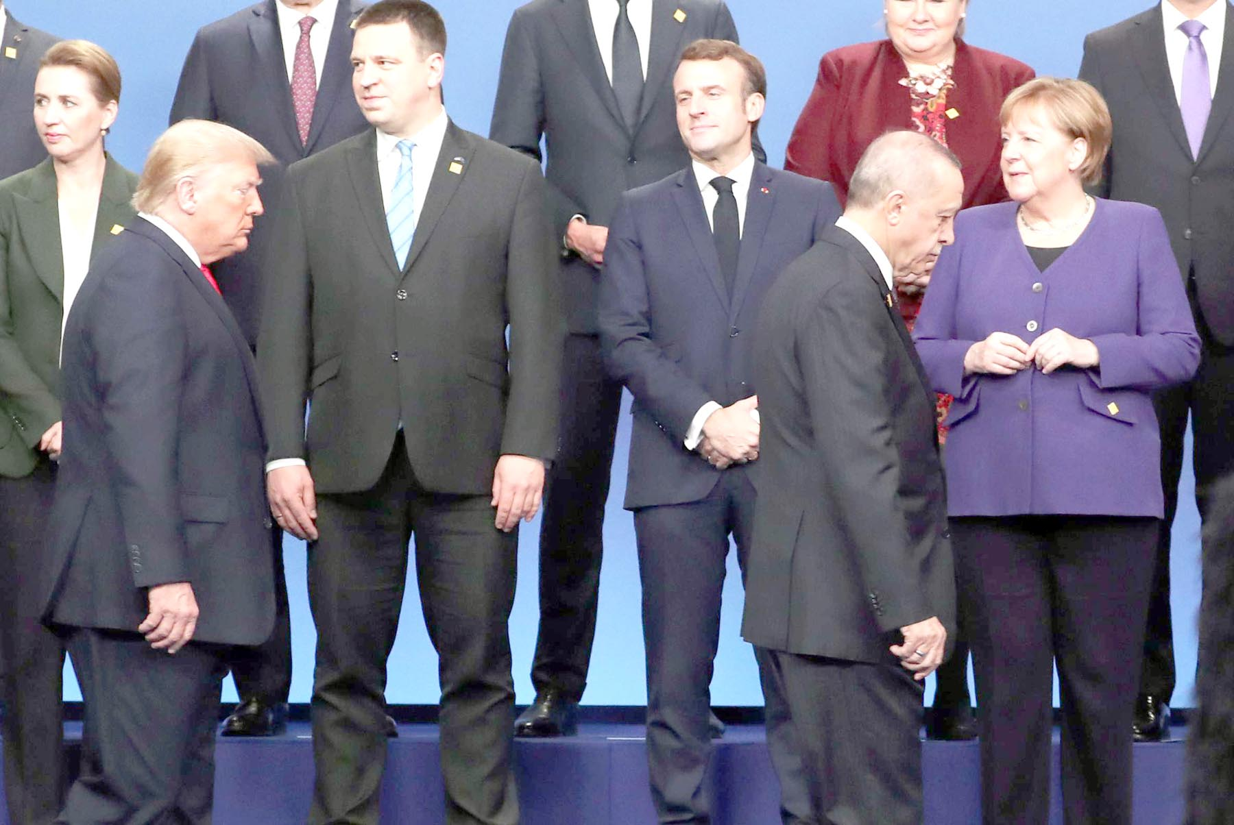 German Chancellor Angela Merkel (R), Turkish President President Tayyip  Erdogan (2nd R), US President Donald Trump (2nd L) and French President Emmanuel  Macron (3rd R) at the NATO leaders summit in Watford, Britain, last December. 	  (Reuters)