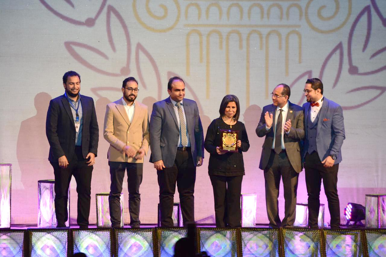 Egyptian actress Salwa Mohamed Ali (C) receives a certificate of recognition  during the opening of the Alexandria Short Film Festival. (Hassan Abdel Zaher)