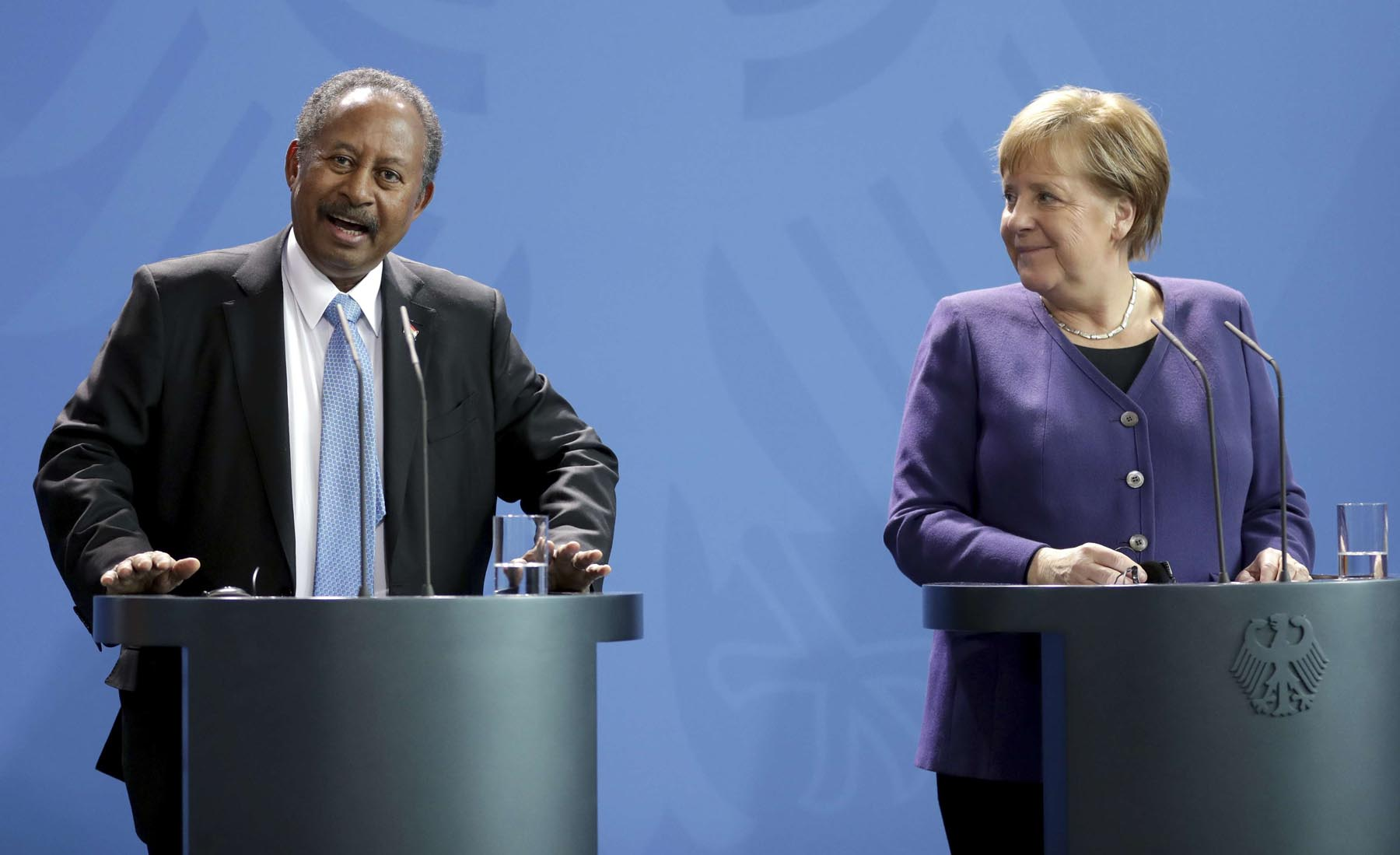 German Chancellor Angela Merkel, right, and the Prime Minister of Sudan, Abdalla Hamdok, left, attend a joint statement in Berlin, Germany, Friday, Feb. 14. (AP)
