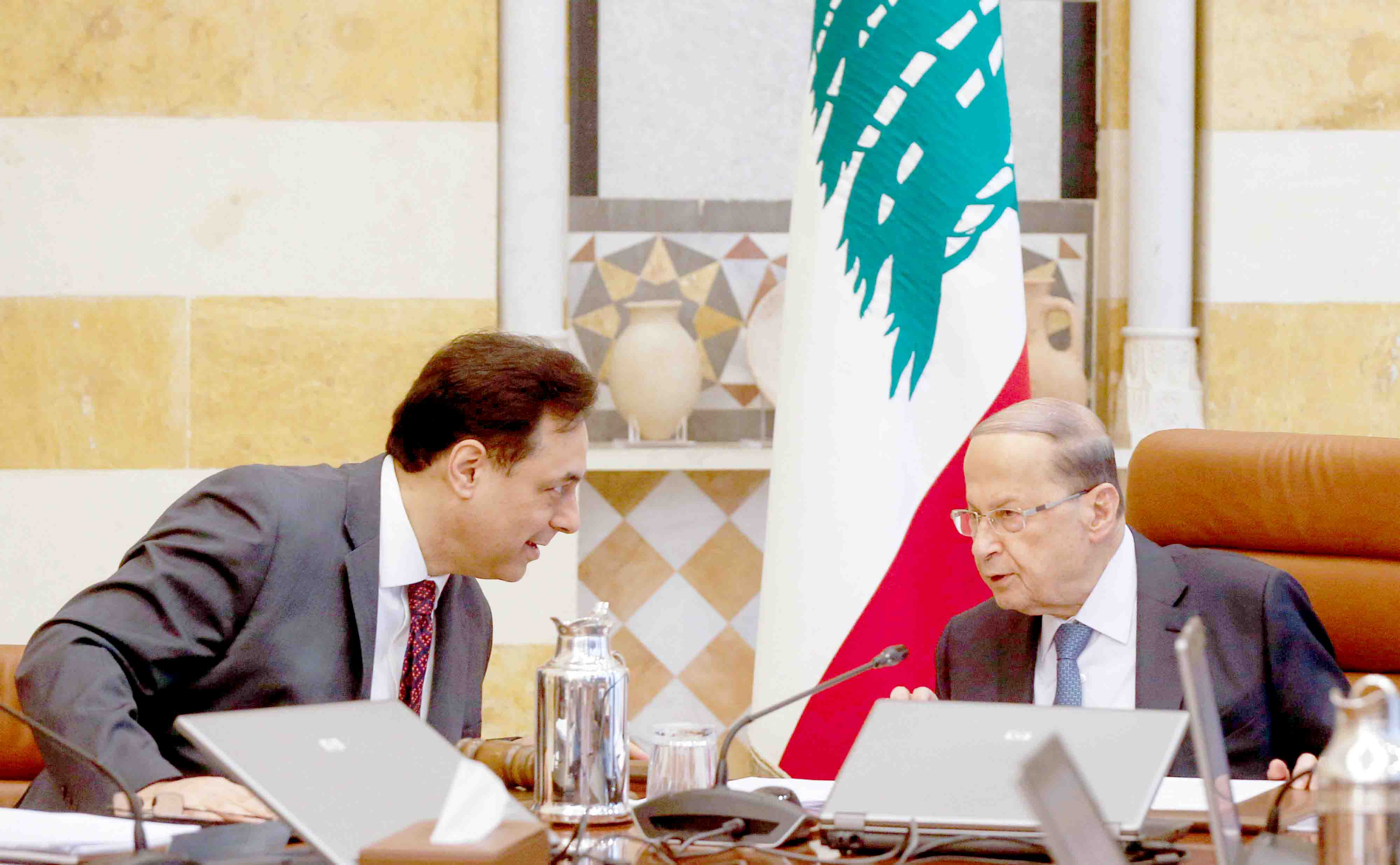 Upset balance. Lebanon's Prime Minister Hassan Diab (L) speaks with President Michel Aoun during a cabinet meeting, February 6. (Reuters)