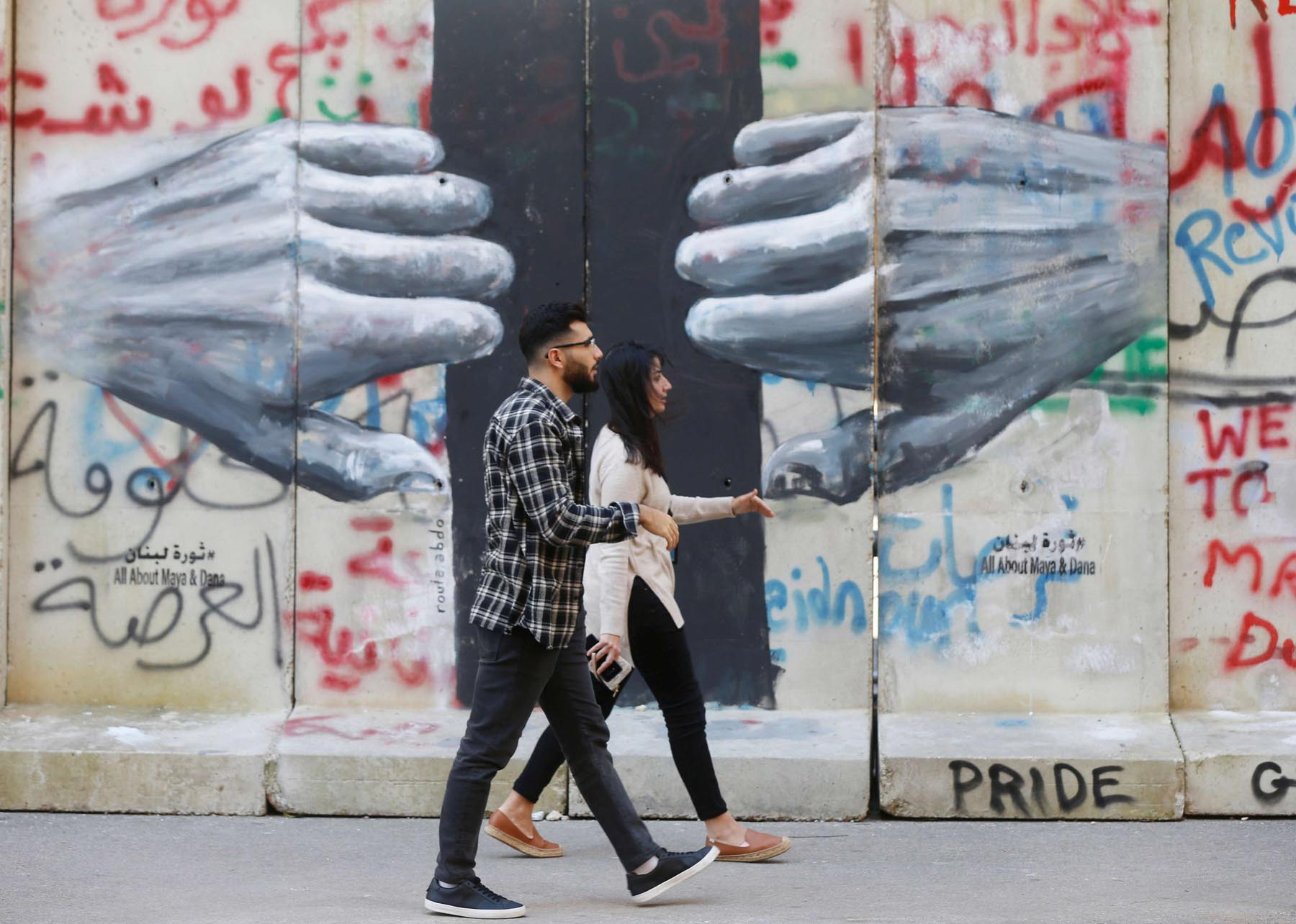 People walk past a mural painted by Lebanese artist Roula Abdo, in downtown Beirut. (Reuters)
