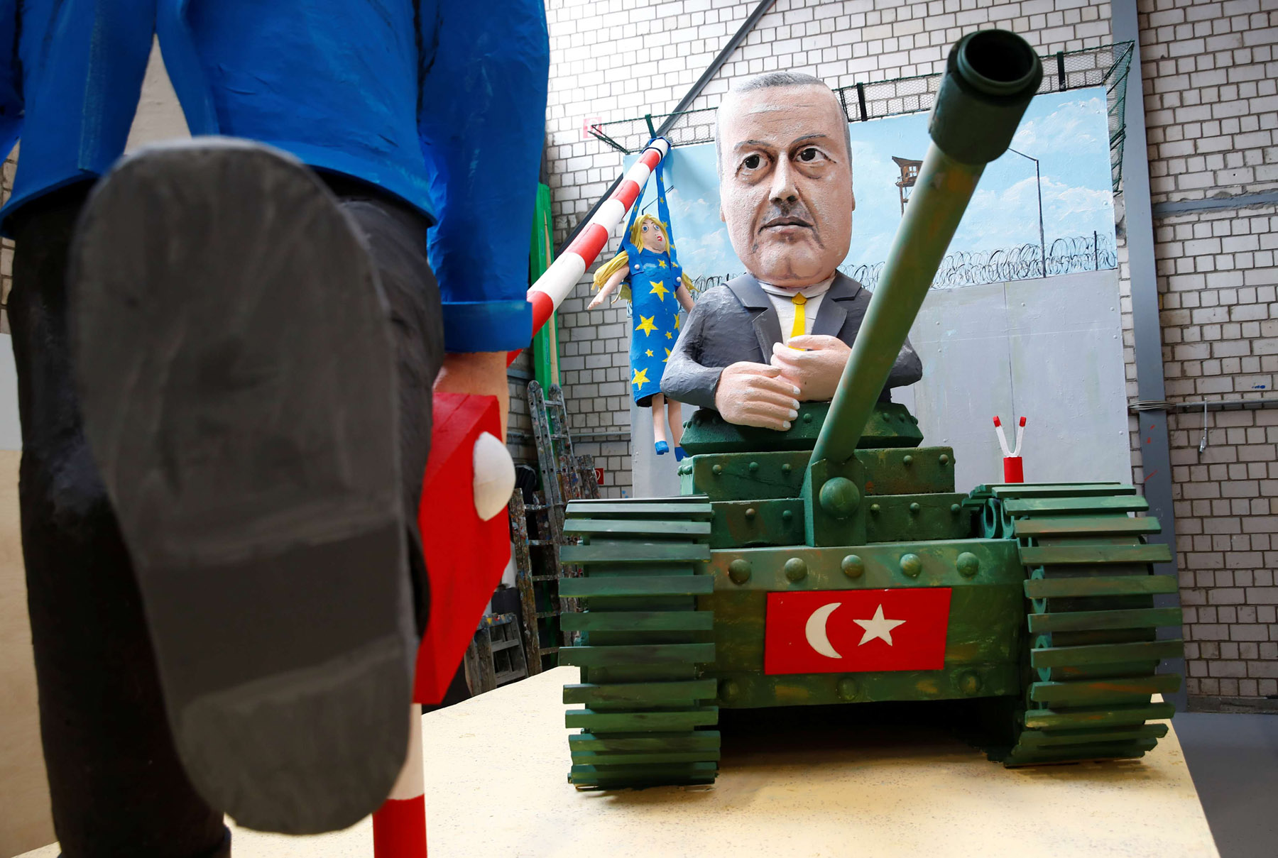 War proclivities. Turkey's President Recip Tayyip Erdogan is depicted on a tank in a carnival float in Cologne, February 18. (Reuters)