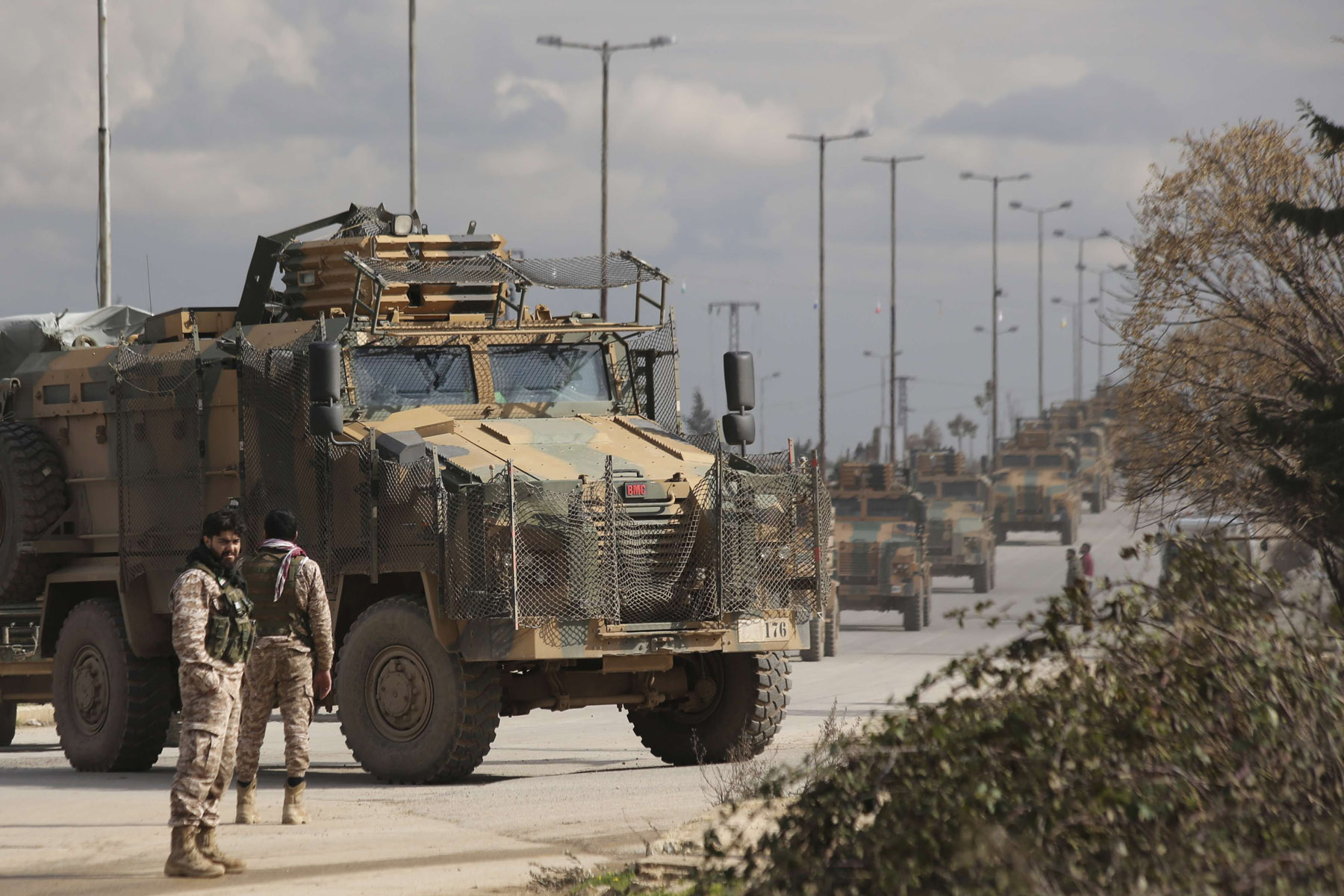 Turkish military convoy drives in Idlib province, Syria, Saturday, February 22. (AP)