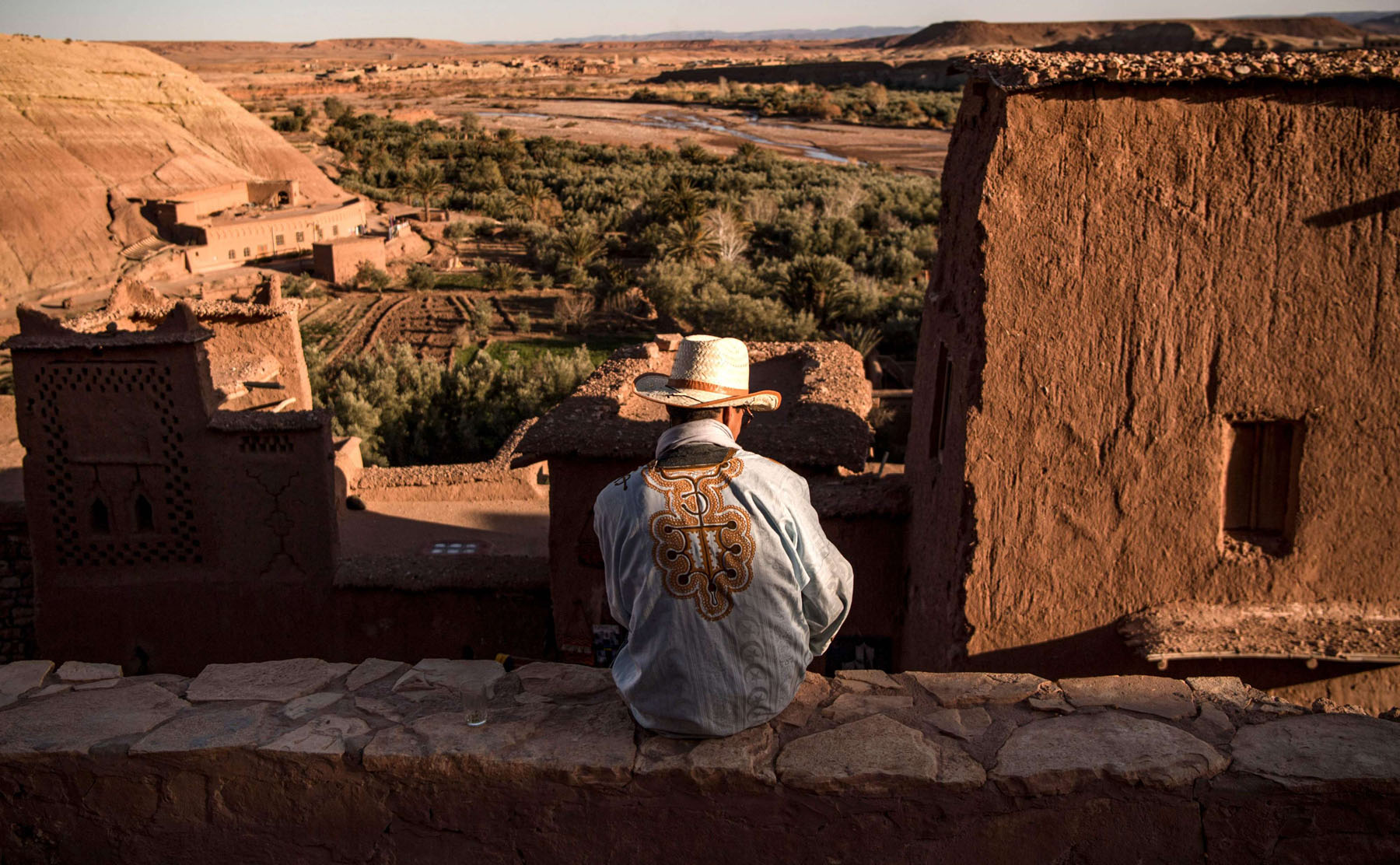 "A man sits atop the ancient fortress of Ait-Ben-Haddou where scenes from the HBO series ""Game of Thrones"" were filmed, south of Morocco's Atlas Mountains. (AFP)"