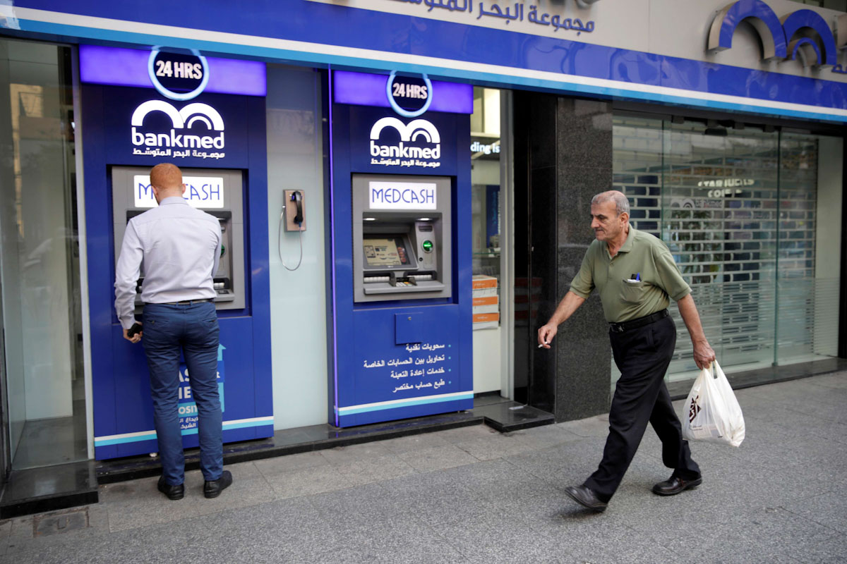 A man walks past a closed bank office in Beirut, Lebanon November 12, 2019. (Reuters)